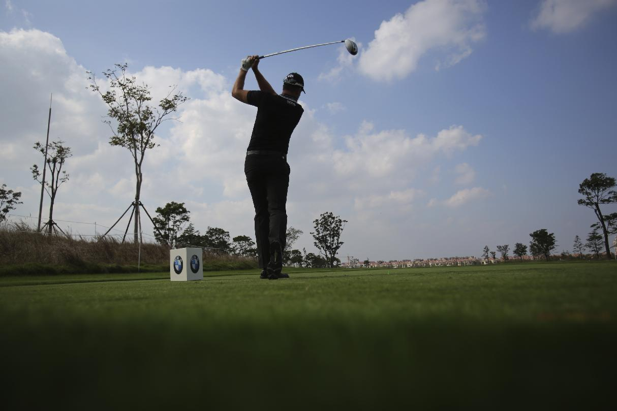 Henrik Stenson of Sweden tees off at the 5th hole during a pro-am competition ahead of the Masters golf tournament at the Lake Malaren Golf Club in Shanghai, China, Wednesday, Oct. 23, 2013. The Shanghai Masters will begin on Oct. 24