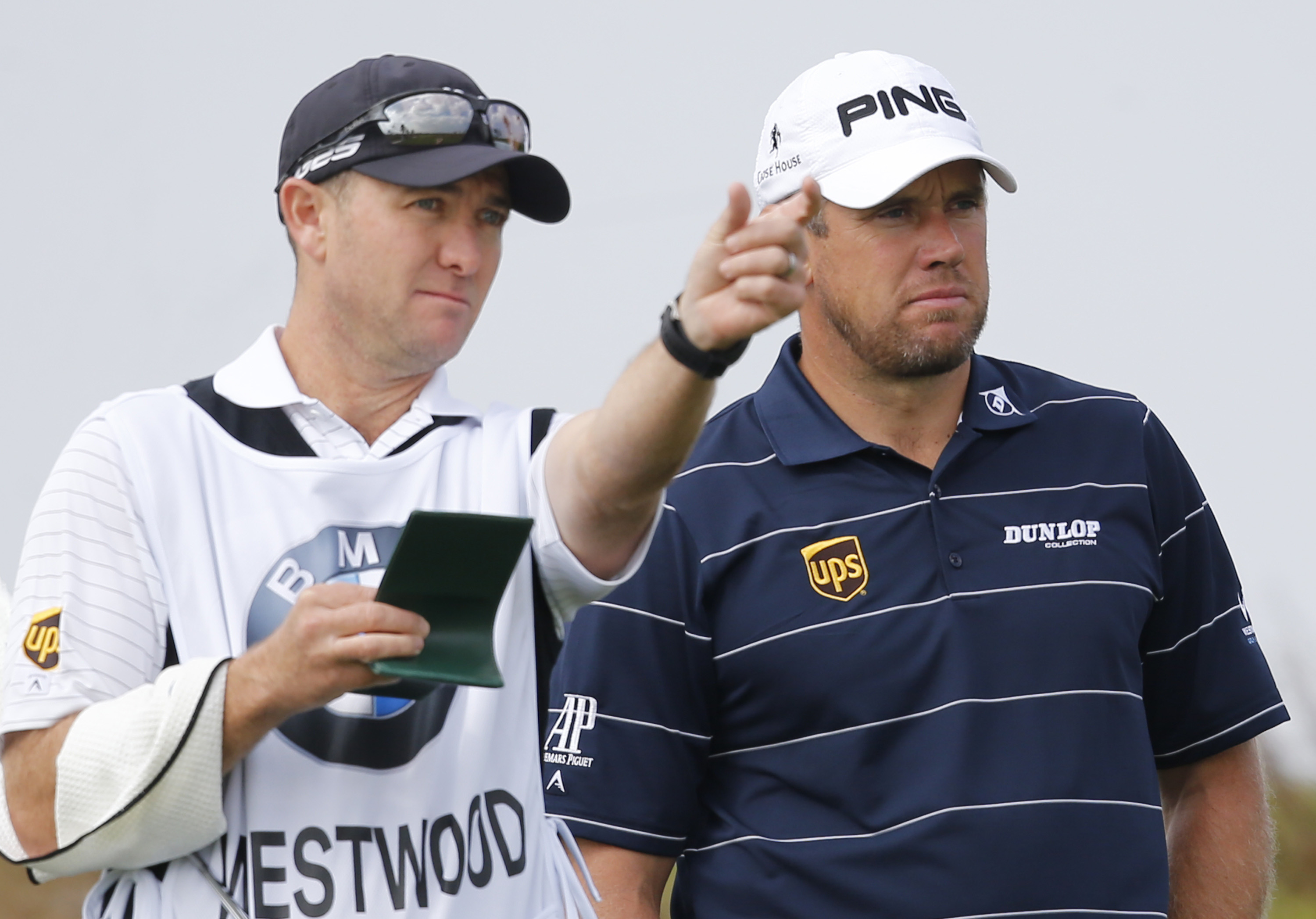 Lee Westwood of England, right, listens his caddie at the 2nd hole during a pro-am competition ahead of the Masters golf tournament at the Lake Malaren Golf Club in Shanghai, China, Wednesday, Oct. 23, 2013. The Shanghai Masters will begin on Oct. 24