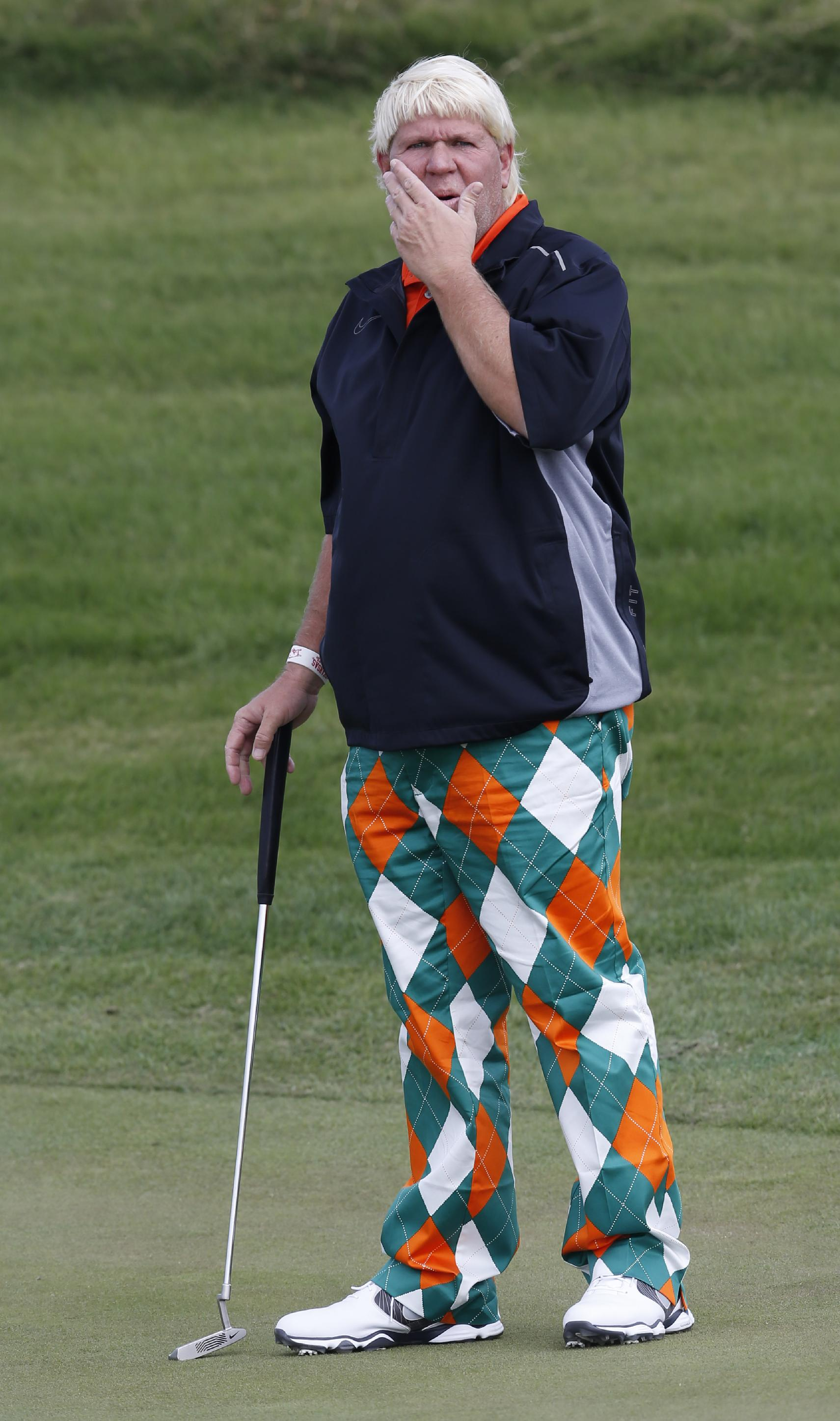John Daly of the U.S. reads the green before putting at the 2nd green during a pro-am competition ahead of the Masters golf tournament at the Lake Malaren Golf Club in Shanghai, China, Wednesday, Oct. 23, 2013. The Shanghai Masters will begin on Oct. 24