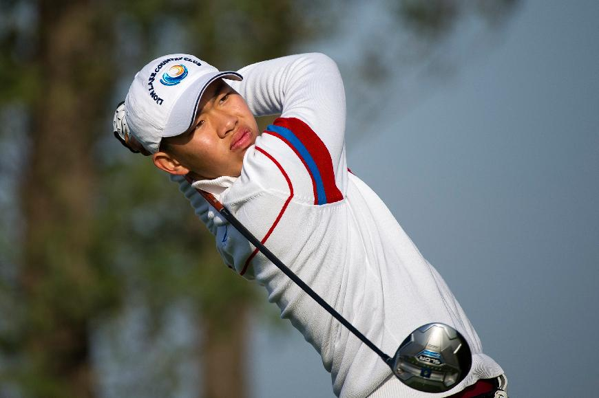 In this photo released by the Asia -Pacific Amateur Championship, Guan Tianlang of China watches his shot during round one of the Asia -Pacific Amateur Championship golf tournament, at Nanshan International Golf Club, Garden Course, in Longkou City, China, Thursday, Oct. 24, 2013