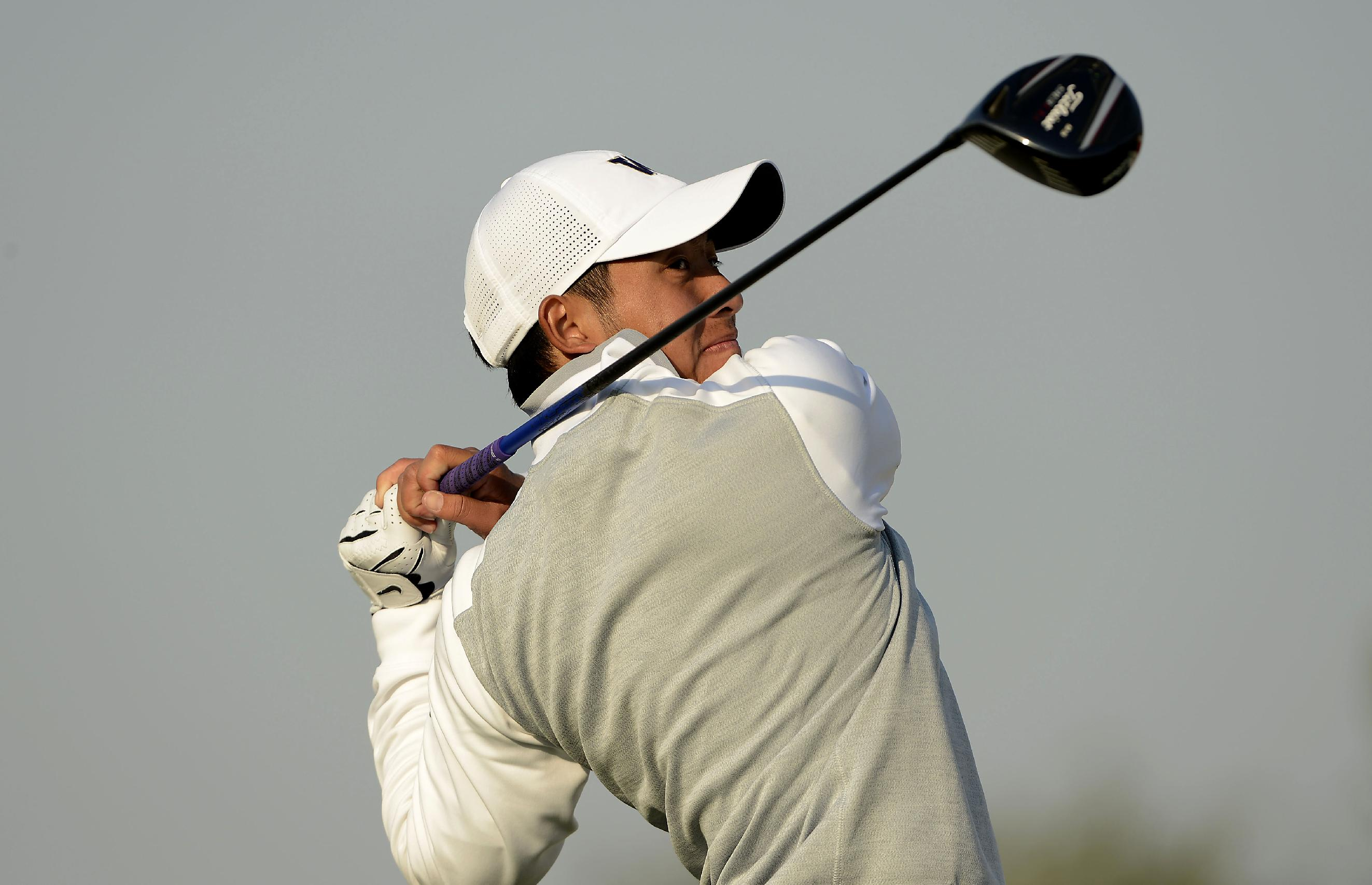 In this photo released by the Asia -Pacific Amateur Championship, Taiwan's Pan Cheng-tsung watches his shot during round one of the Asia -Pacific Amateur Championship golf tournament at Nanshan International Golf Club, Garden Course, in Longkou City, China on Thursday, Oct. 24, 2013