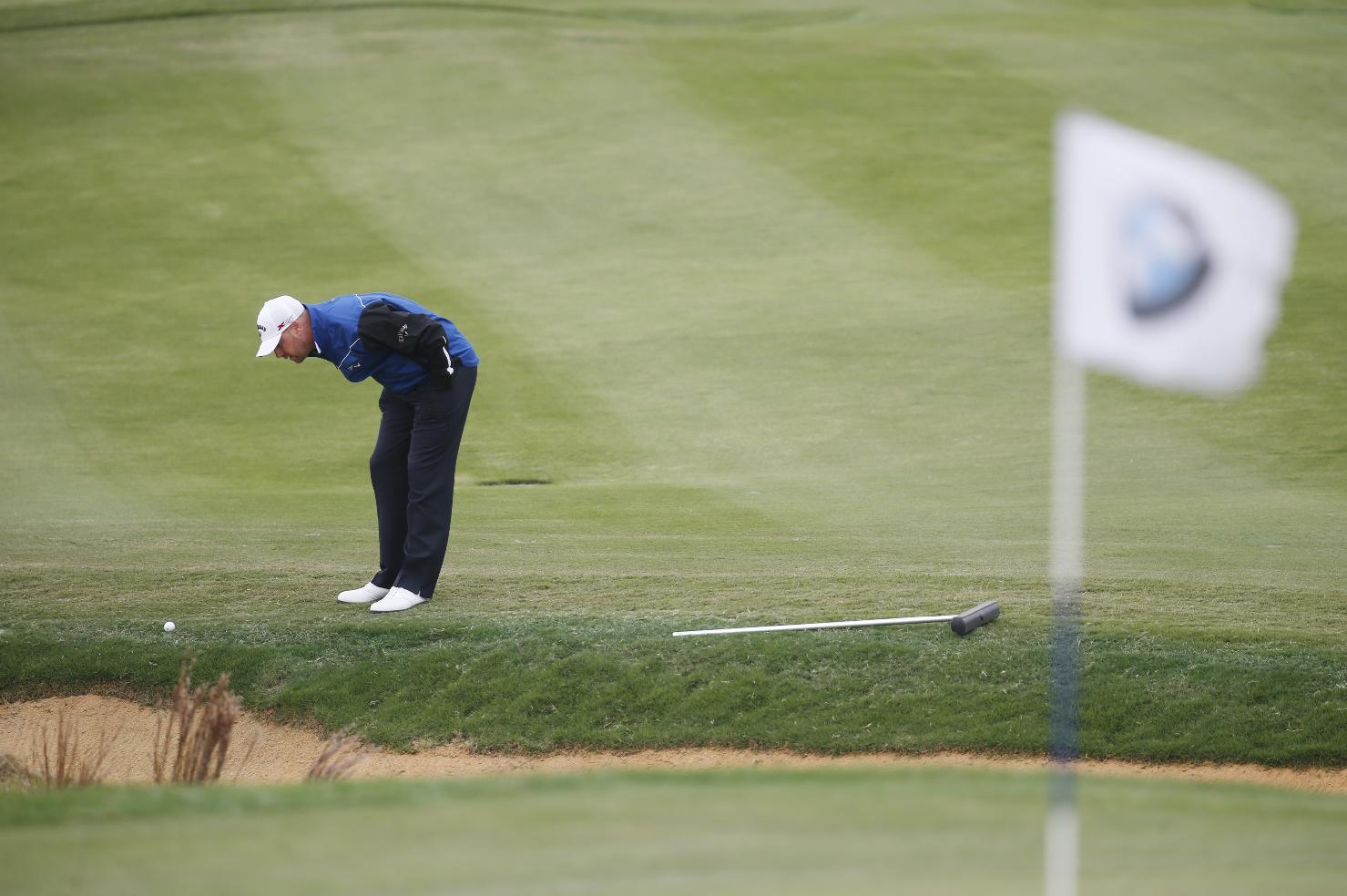 Craig Lee of Scotland looks at his shot on the edge of sound bunker on the 7th green during the second round of the BMW Masters golf tournament at the Lake Malaren Golf Club in Shanghai, China, Friday, Oct. 25, 2013