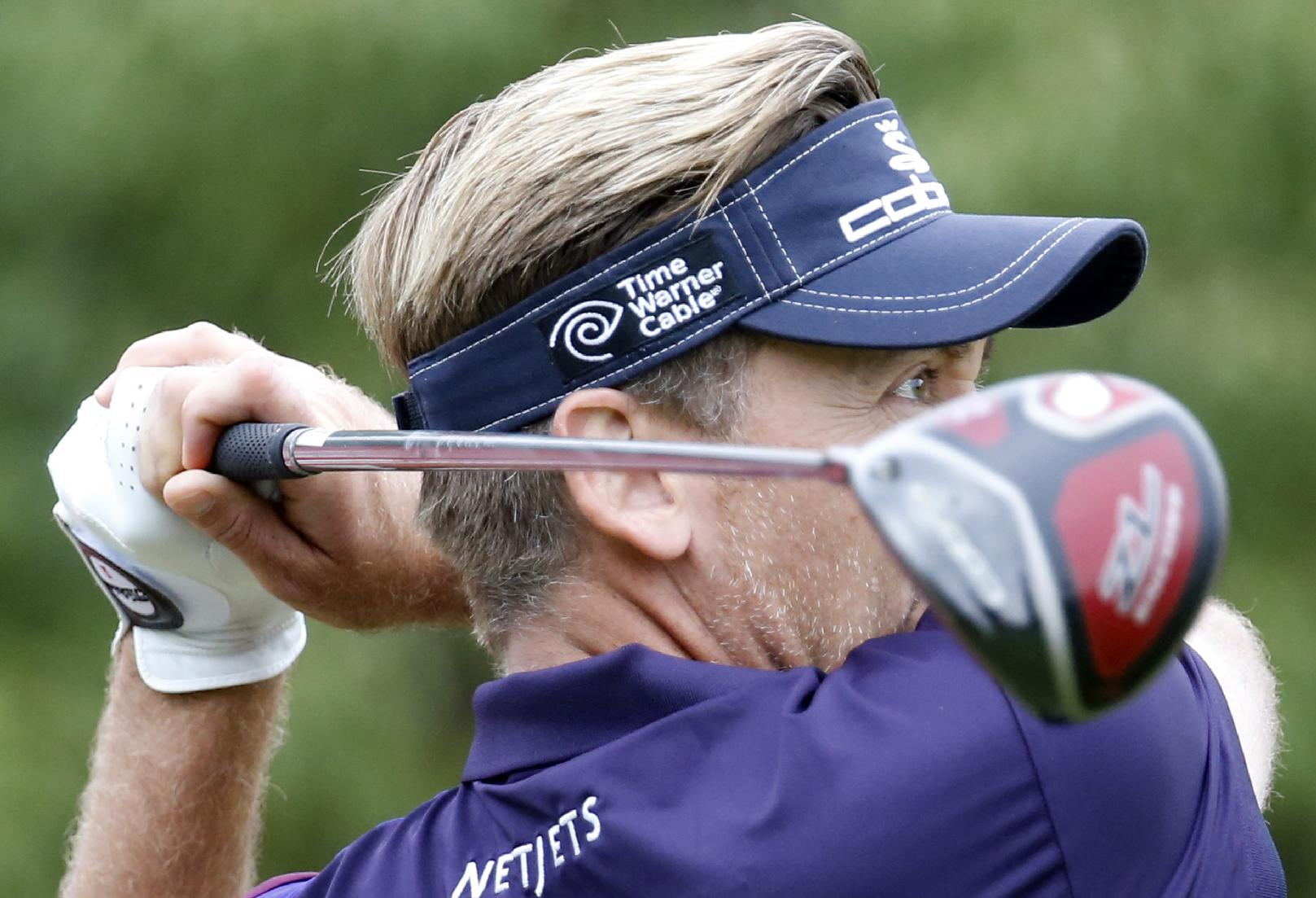 Defending champion Ian Poulter of England tees off on the 2nd hole during the first round of the HSBC Champions golf tournament at the Sheshan International Golf Club in Shanghai, China, Thursday, Oct. 31, 2013
