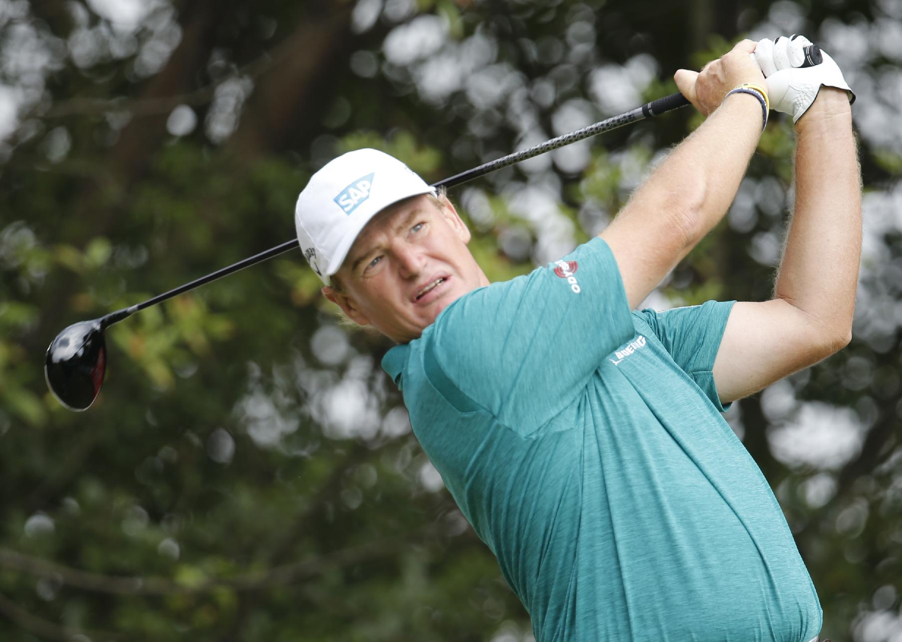 South African Ernie Els tees off the 9th hole during the second round of the HSBC Champions golf tournament at the Sheshan International Golf Club in Shanghai, China, Friday, Nov. 1, 2013