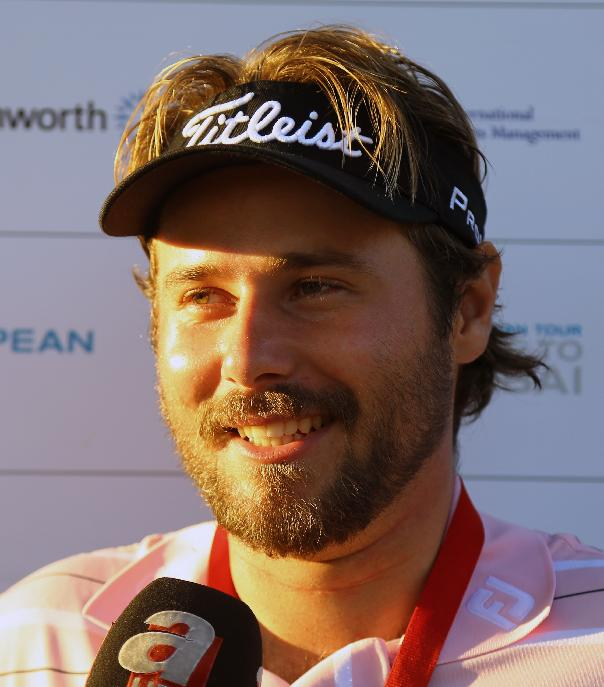 Victor Dubuisson of France smiles after his victory in the Turkish Open golf tournament at the Montgomerie Maxx Royal Course in Antalya, Turkey, Sunday, Nov. 10, 2013
