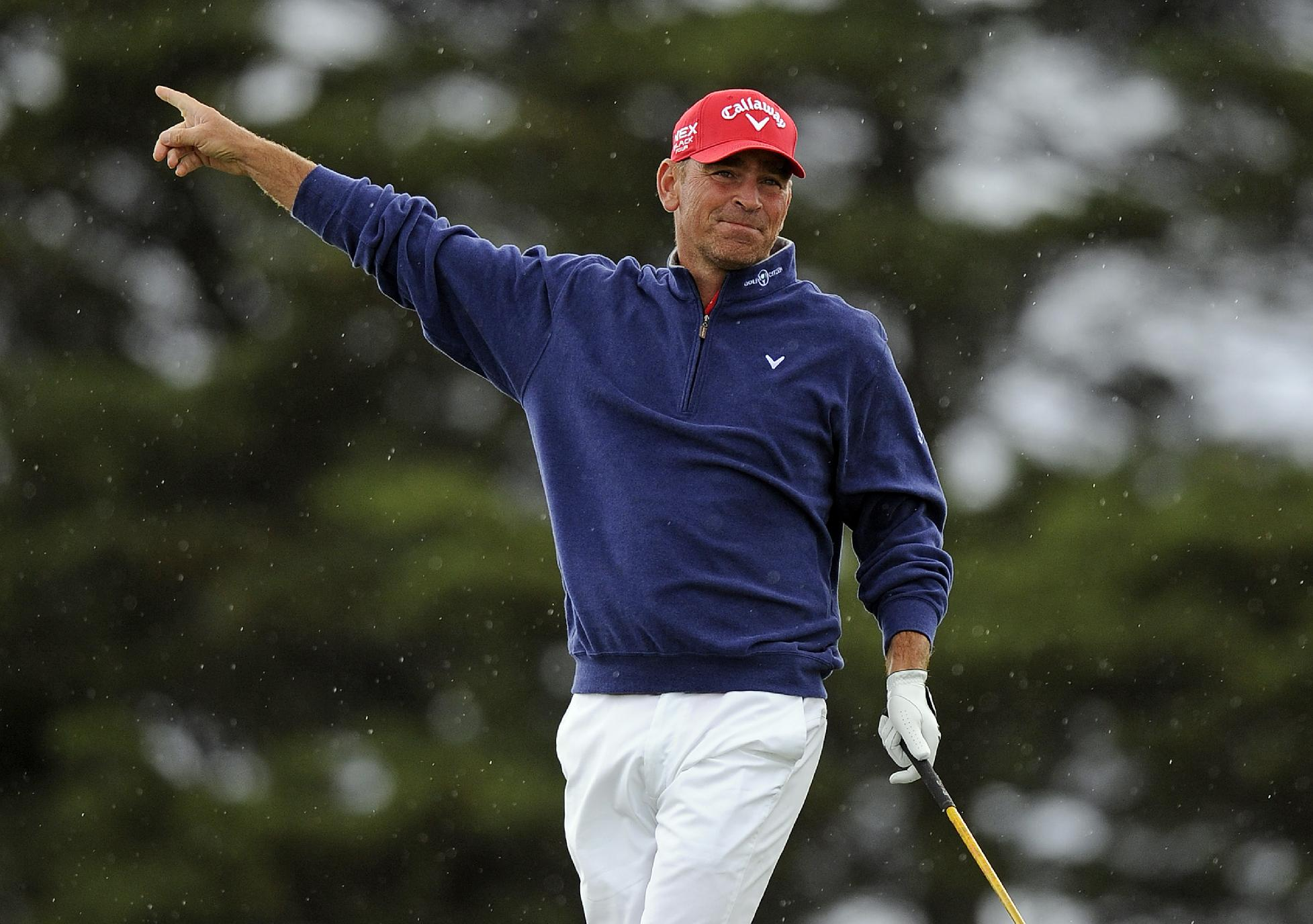 Thomas Bjorn of Denmark gestures after hitting his approach shot into the rough on the second hole during the final round of the World Cup of Golf at Royal Melbourne Golf Course in Australia, Sunday, Nov. 24, 2013