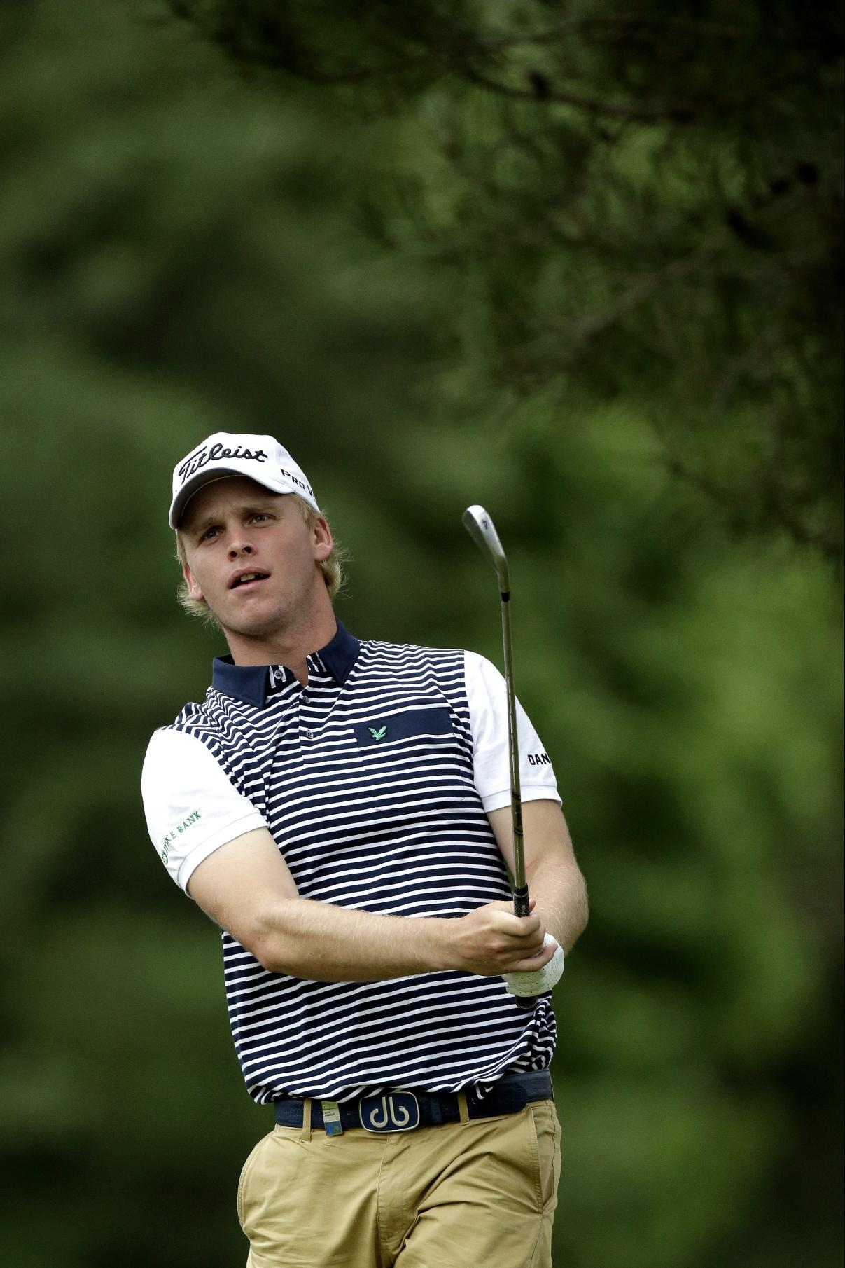 Morten Orum Madsen, of Denmark, tees off on the eighth hole during the first round of the U.S. Open golf tournament at Merion Golf Club, Friday, June 14, 2013, in Ardmore, Pa