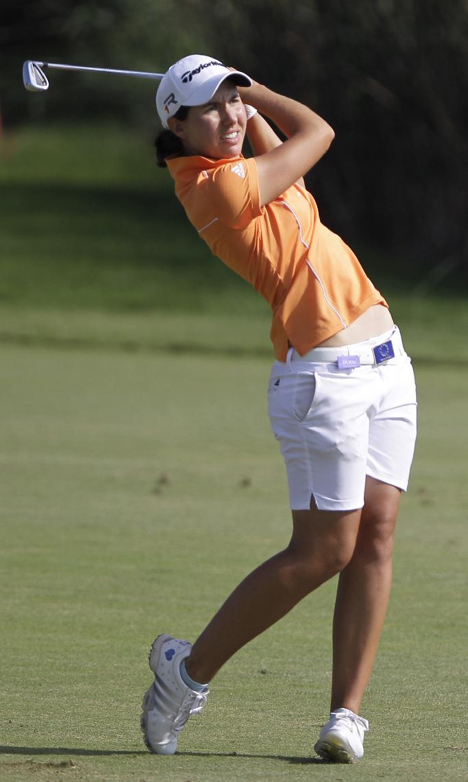 Carlota Ciganda of Spain follows her ball on the 9th hole during the 2nd round of Dubai Ladies  Masters golf tournament in Dubai, United Arab Emirates, Thursday Dec. 5, 2013