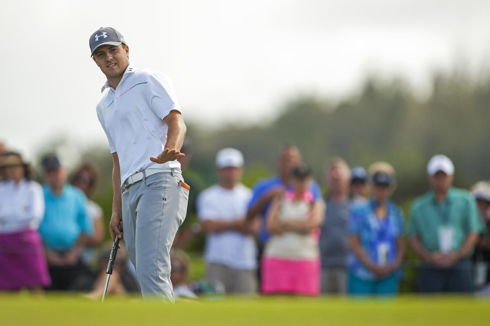 Jordan Spieth reacts to his putt on the 10th green during the final round of the Tournament of Champions golf tournament, Monday, Jan. 6, 2014, in Kapalua, Hawaii