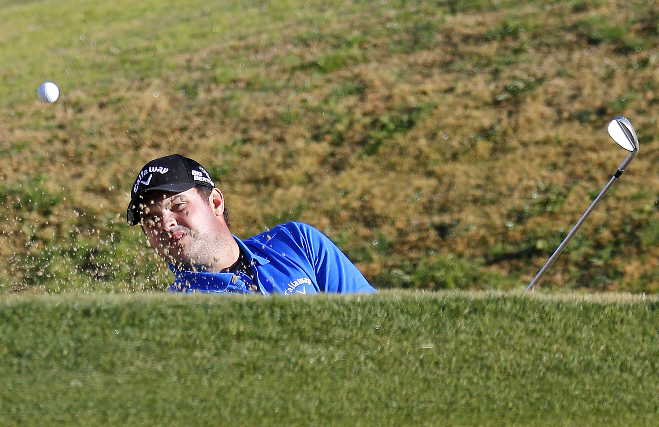 Patrick Reed hits out of a bunker on the 11th hole during the third round of the Humana Challenge PGA golf tournament on the Nicklaus Private course at PGA West, Saturday, Jan. 18, 2014, in La Quinta, Calif