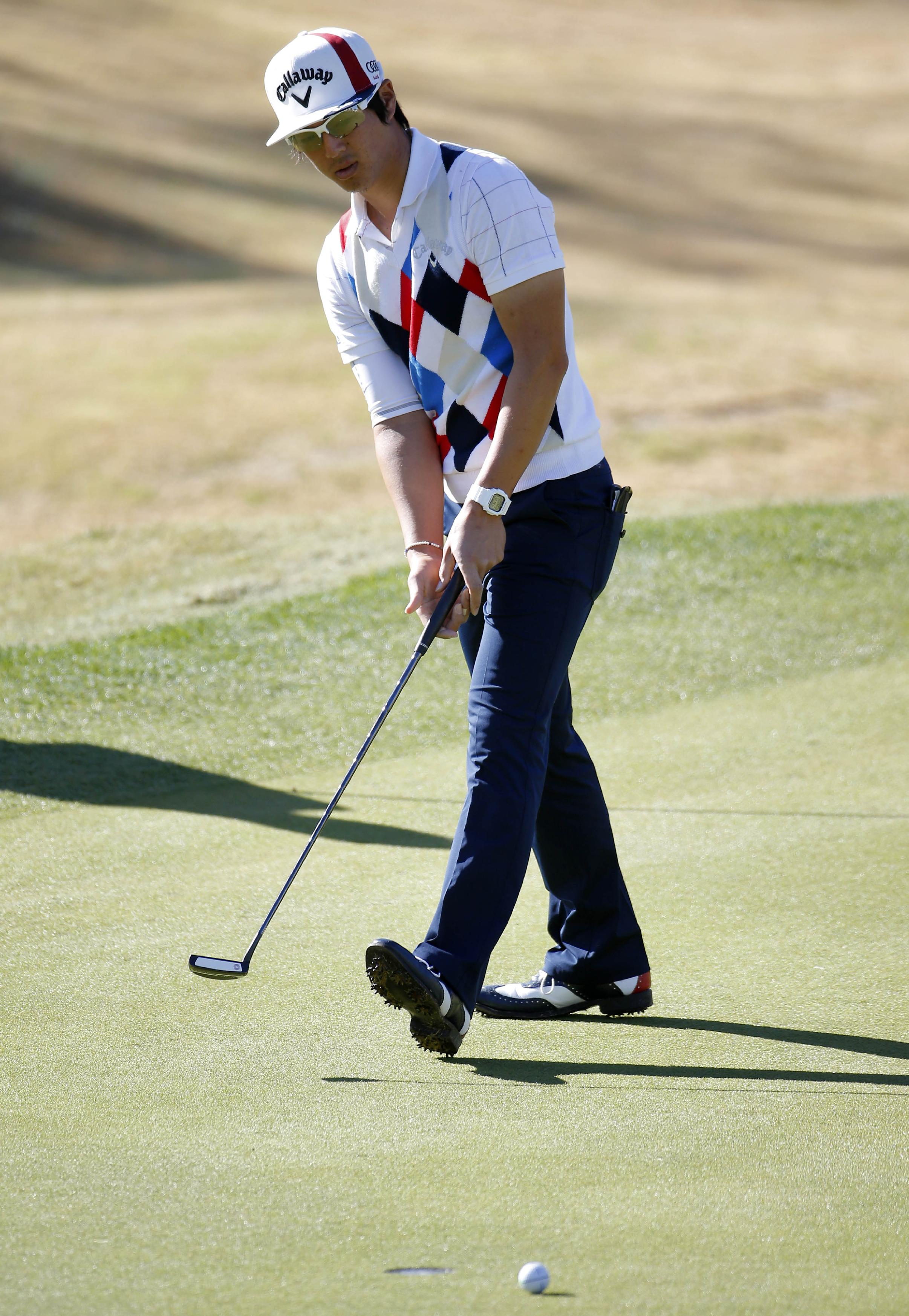 Ryo Ishikawa, of Japan, misses a birdie putt on the eighth green during the third round of the Humana Challenge PGA golf tournament on the Nicklaus Private course at PGA West, Saturday, Jan. 18, 2014, in La Quinta, Calif