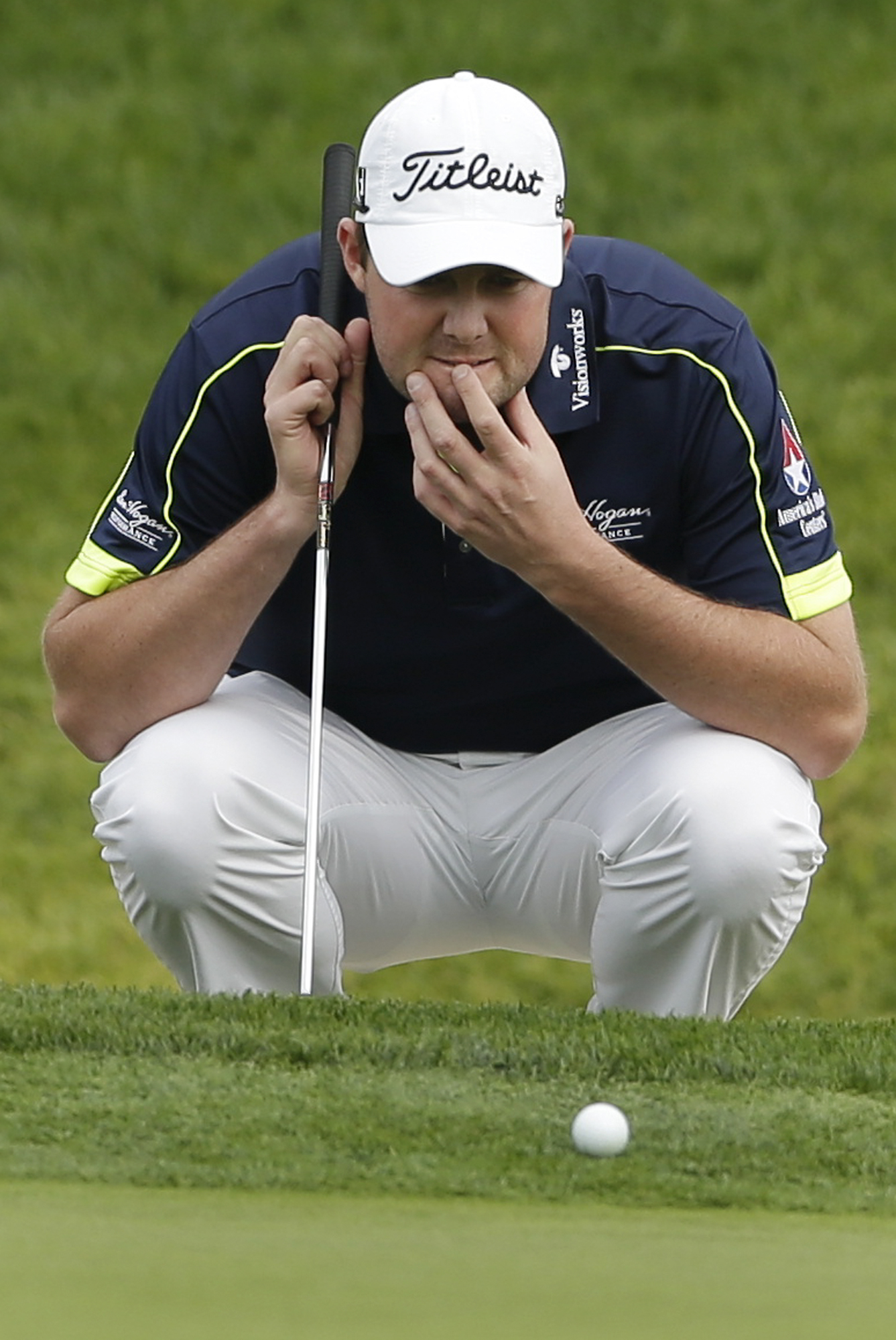 Marc Leishman, of Australia, eyes his line just off the 18th green of the south course during the second round of the Farmers Insurance Open golf tournament Friday, Jan. 24, 2014, in San Diego