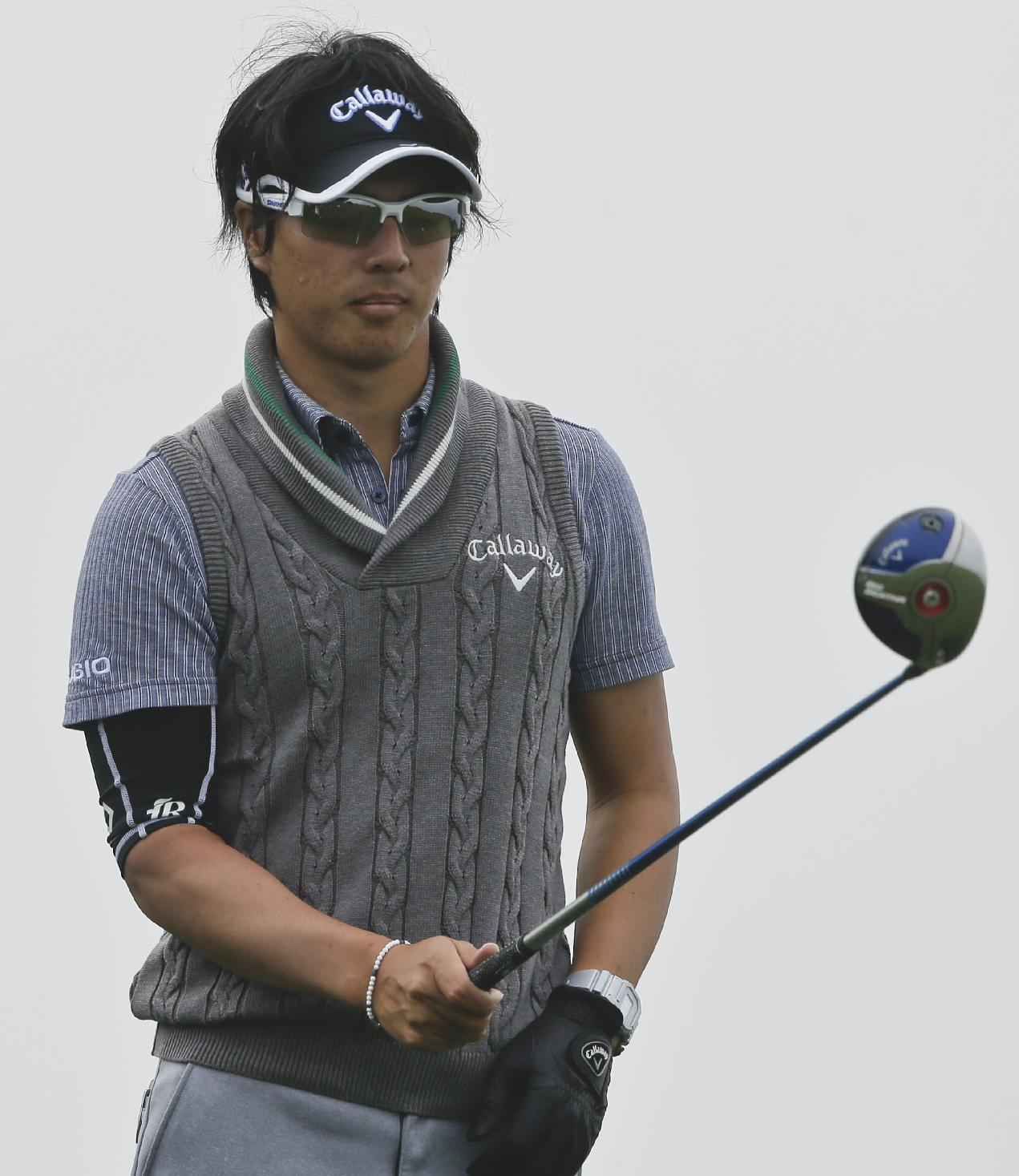 Ryo Ishikawa, of Japan, lines up his tee shot on 4th hole of the South Course at Torrey Pines during the final round of the Farmers Insurance Open golf tournament Sunday, Jan. 26, 2014, in San Diego