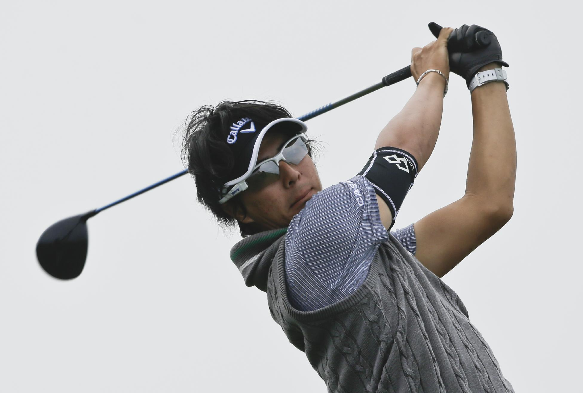 Ryo Ishikawa, of Japan, hits the ball on the 4th hole of the South Course at Torrey Pines during the final round of the Farmers Insurance Open golf tournament Sunday, Jan. 26, 2014, in San Diego