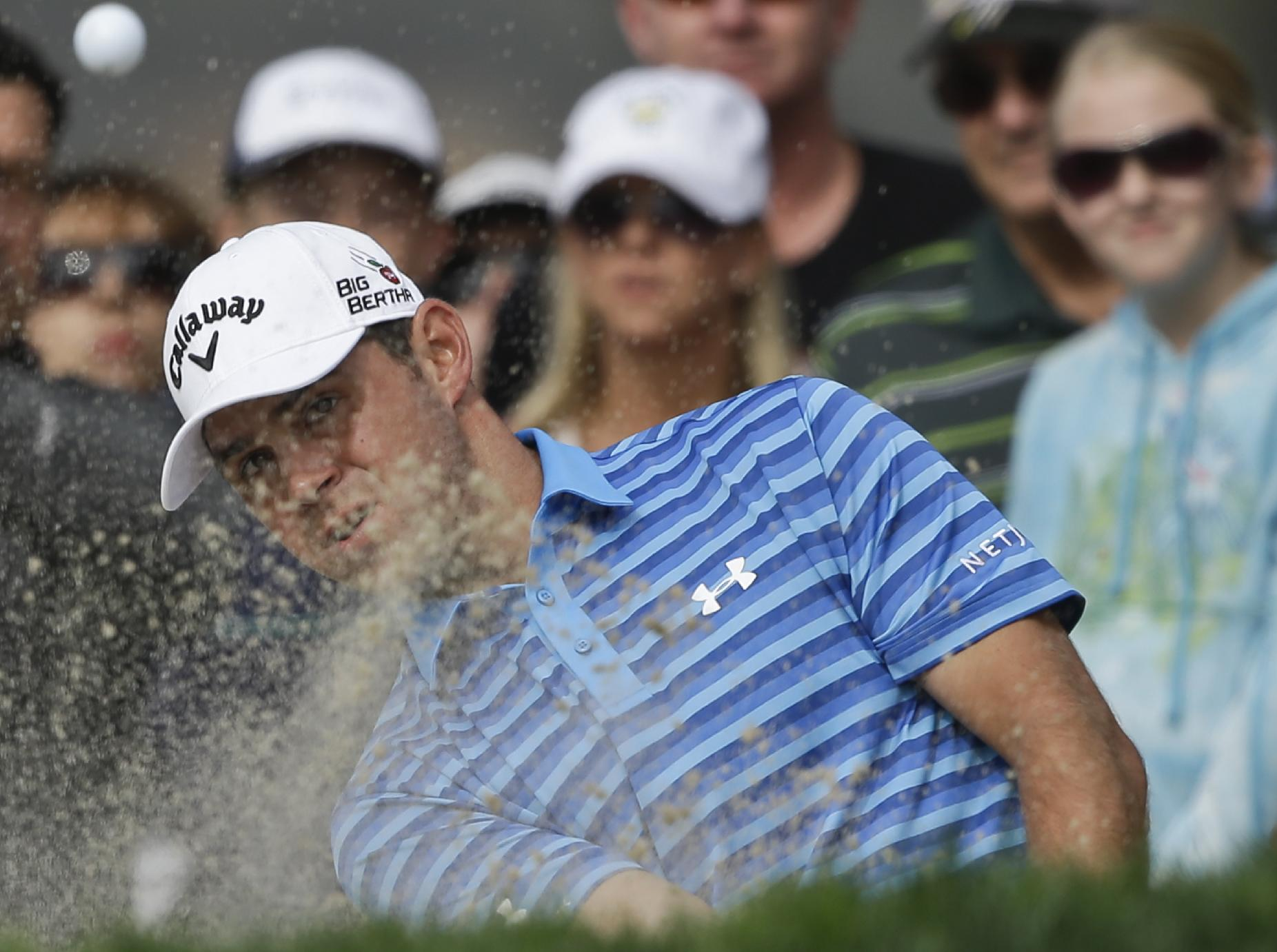 Gary Woodland shoots from the bunker on sixth hole of the South Course at Torrey Pines during the final round of the Farmers Insurance Open golf tournament Sunday, Jan. 26, 2014, in San Diego