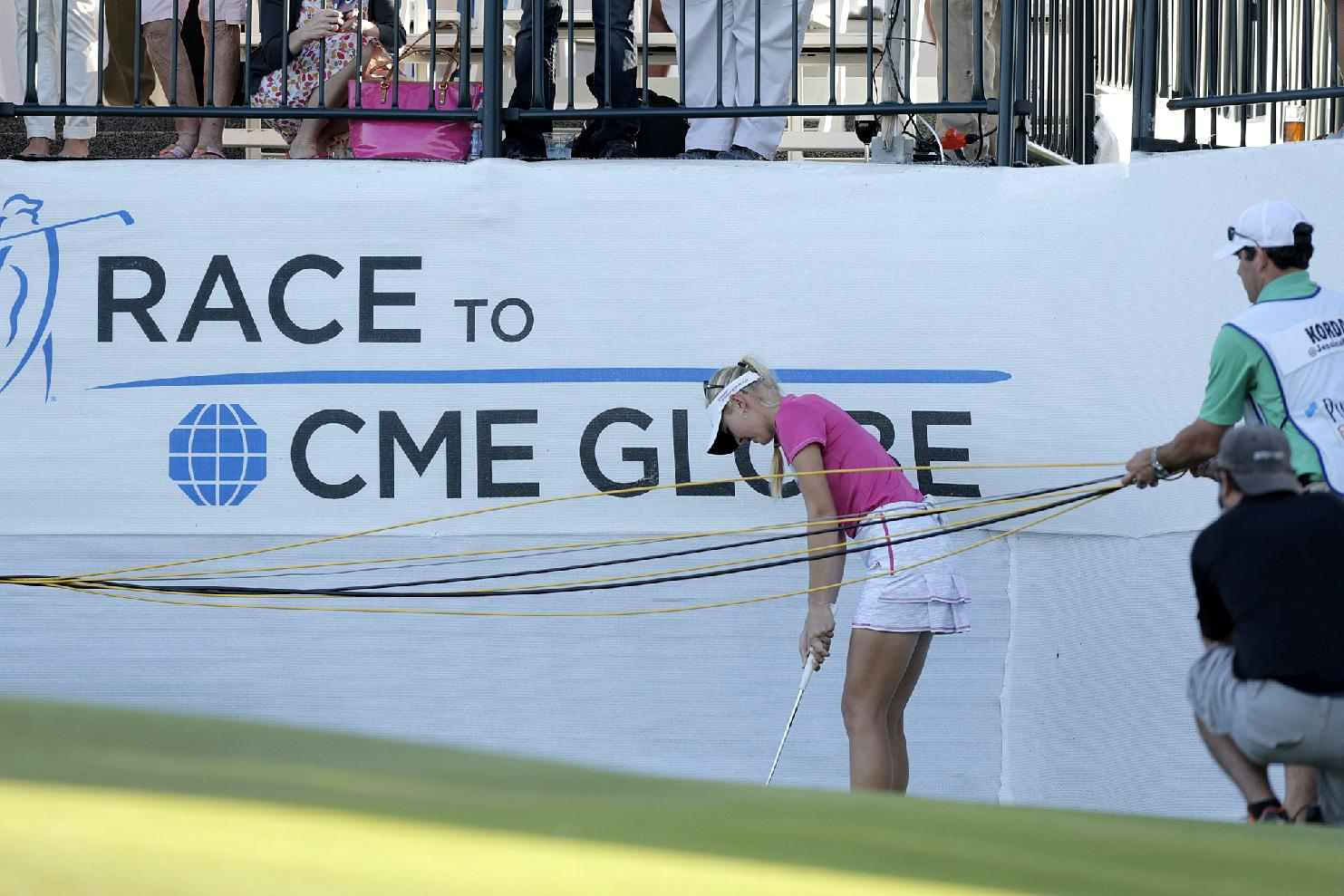 Jessica Korda of the U.S. has to chip over some wires on the 18th during the last day of the LPGA Pure Silk Bahamas Classic at the Ocean Club Golf Course, Paradise Island, Bahamas, Sunday, Jan. 26, 2014