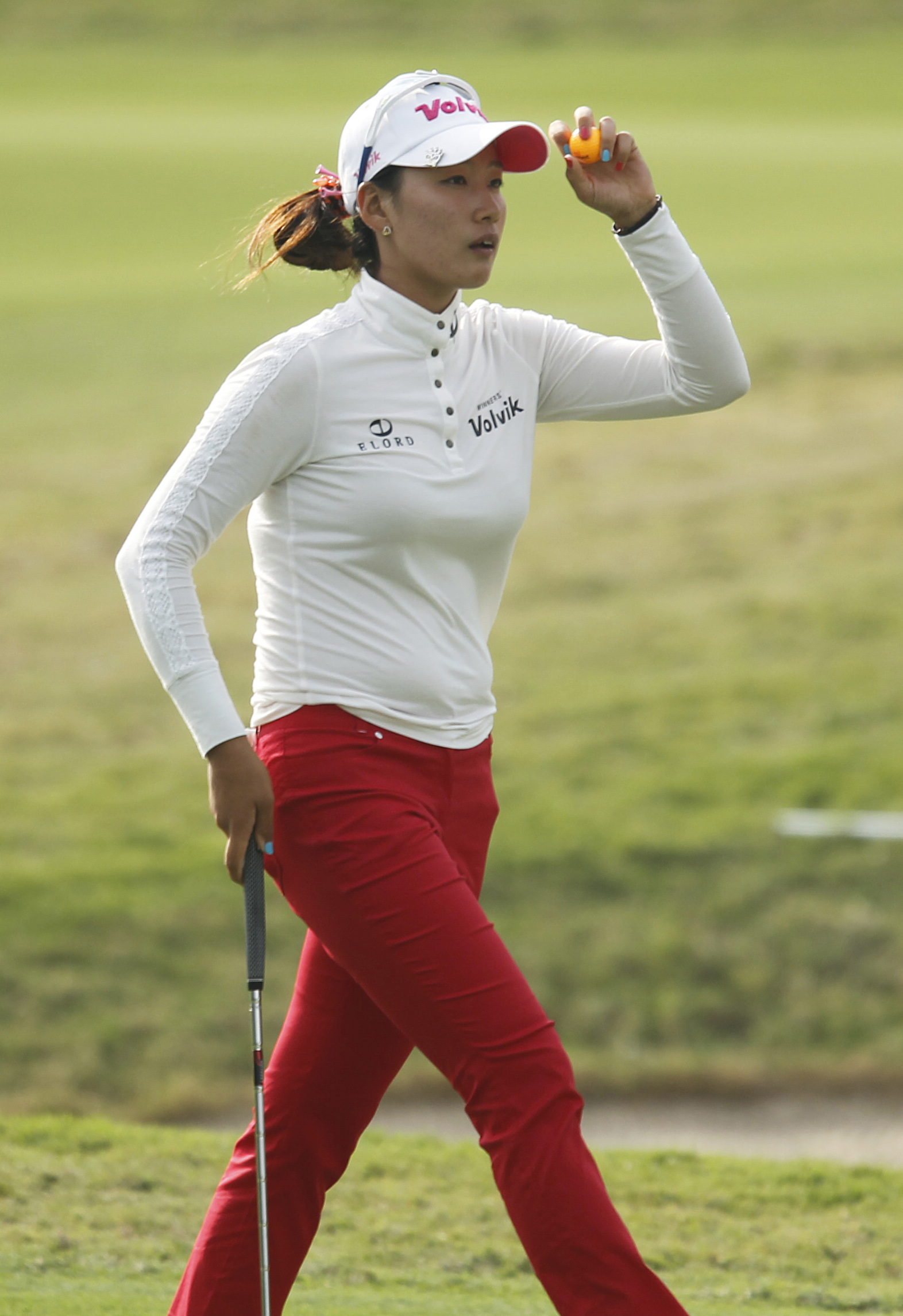 Chella Choi of South Korea waves with her ball as she finished the 18th hole during the second day of the Sunrise LPGA Taiwan Championship tournament at the Sunrise Golf & Country Club, Friday, Oct. 25, 2013, in Yangmei, north eastern Taiwan. Choi finished in 6th position carding an even par at 72