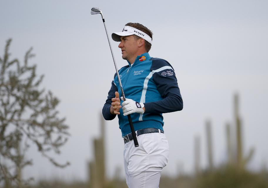 Ian Poulter, of England, watches his tees on the fourth hole against Rickie Fowler during the first round of the Match Play Championship golf tournament on Wednesday, Feb. 19, 2014, in Marana, Ariz