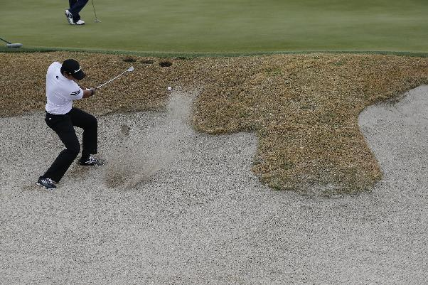 Jason Day, of Australia, hits from the sand on the fourth hole in his match against Thorbjorn Olesen, of Denmark, during the first round of the Match Play Championship golf tournament on Wednesday, Feb. 19, 2014, in Marana, Ariz