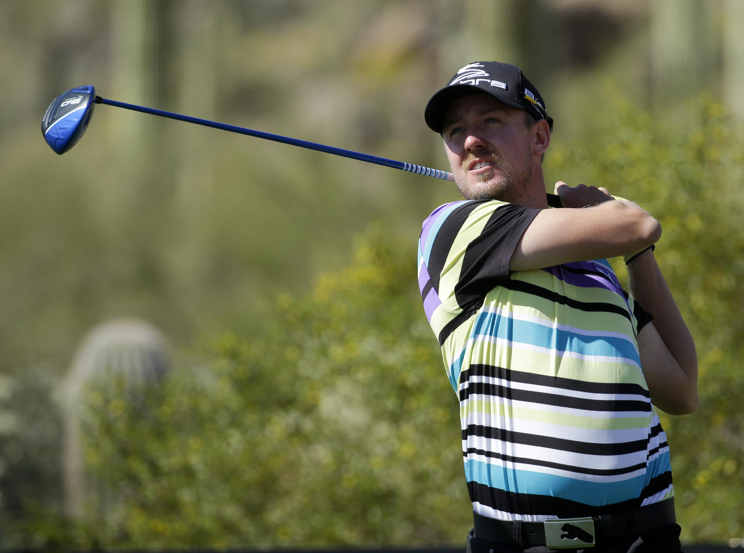 Jonas Blixt, of Sweden, watches his tee shot on the 17th hole in his second-round match against Bubba Watson during the Match Play Championship golf tournament Thursday, Feb. 20, 2014, in Marana, Ariz