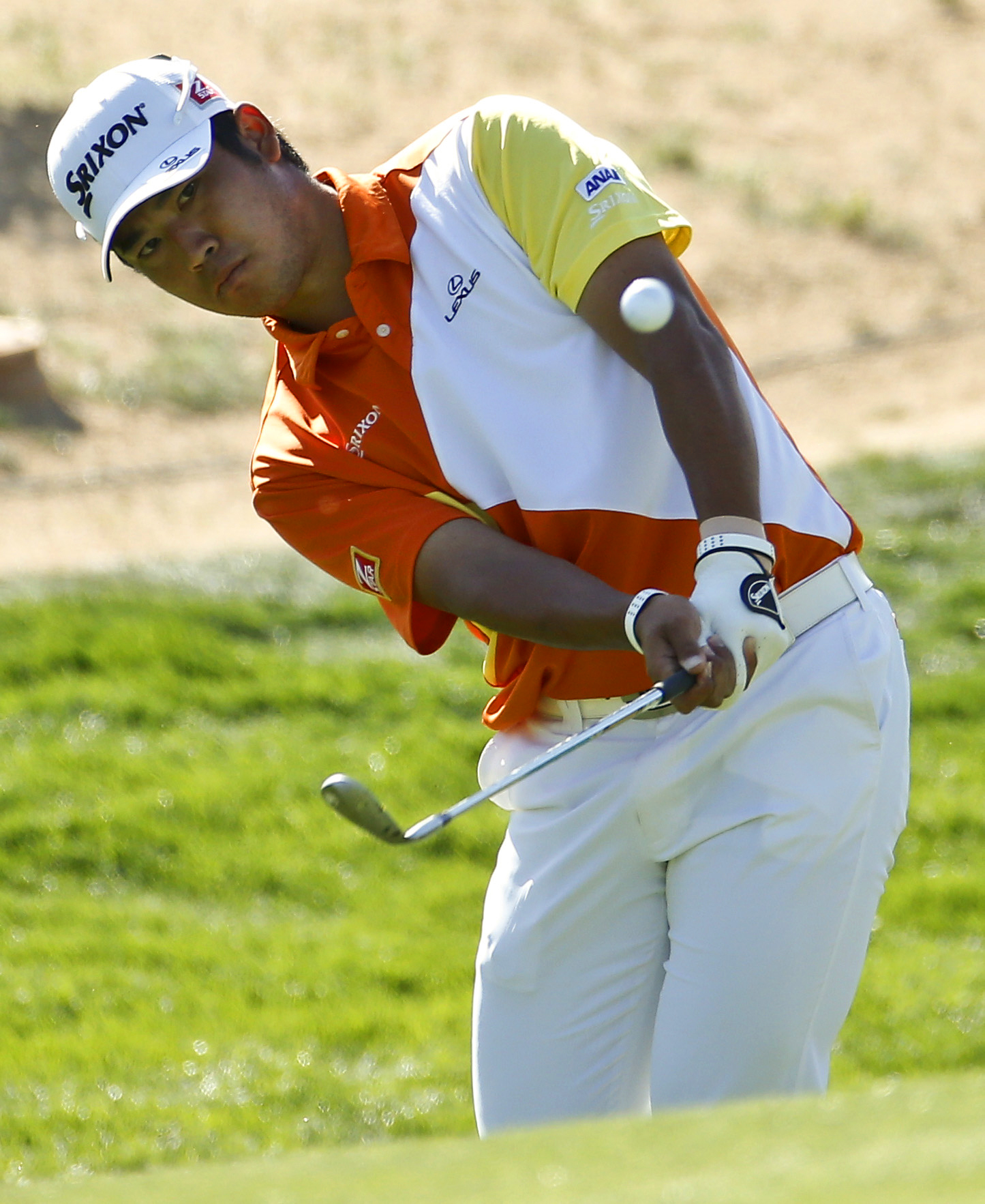 Hideki Matsuyama, of Japan, hits a chip shot on the 15th hole in his match against Graeme McDowell, of Northern Ireland, during the second round of the Match Play Championship golf tournament on Thursday, Feb. 20, 2014, in Marana, Ariz