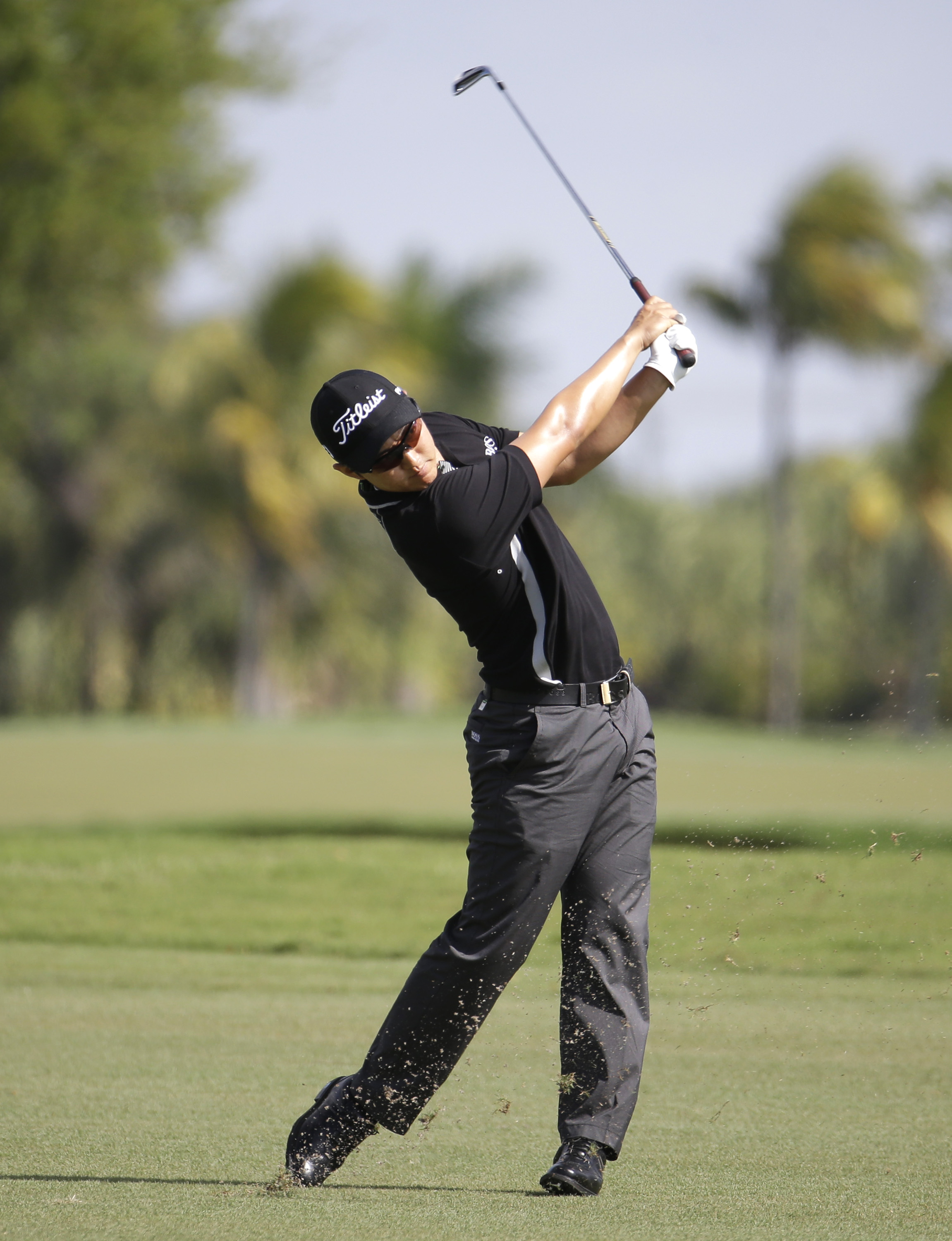 Jin Jeong of South Korea hits from the eighth fairway during a continuation of the first round of the Cadillac Championship golf tournament, Friday, March 7, 2014, in Doral, Fla. Play was suspended before the end of play Thursday due to severe weather