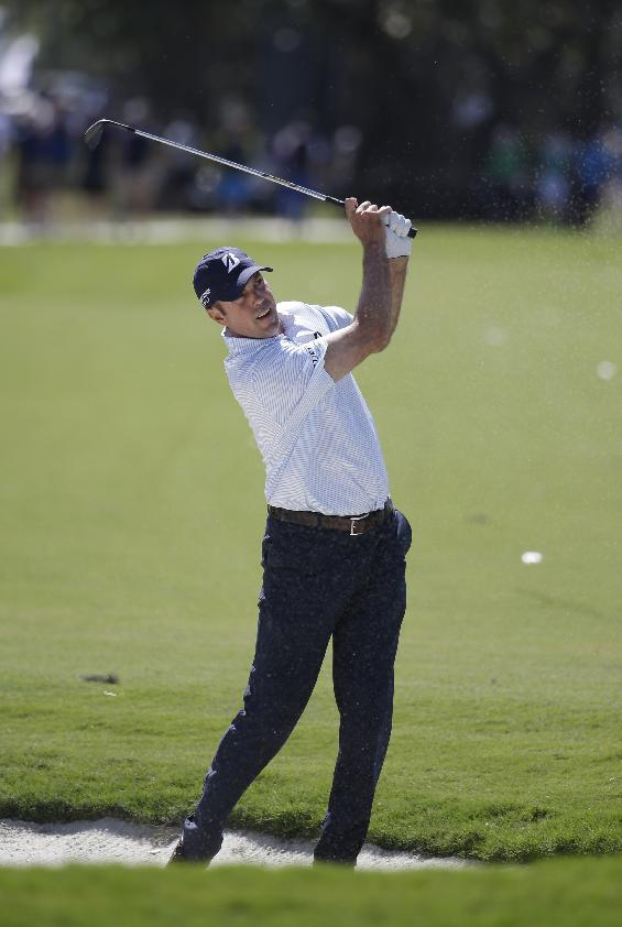 Matt Kuchar hits from the fifth fairway during the second round of the Cadillac Championship golf tournament on Friday, March 7, 2014, in Doral, Fla