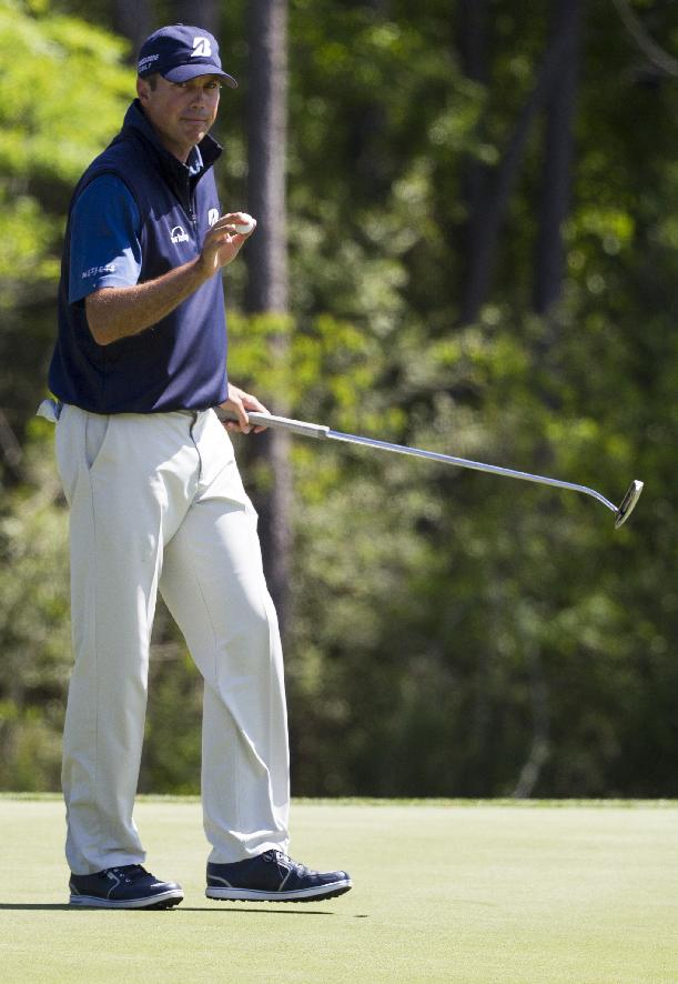 Matt Kuchar reacts after a par on the nine hole during the second round of the Houston Open golf tournament, Friday, April 4, 2014, in Humble, Texas