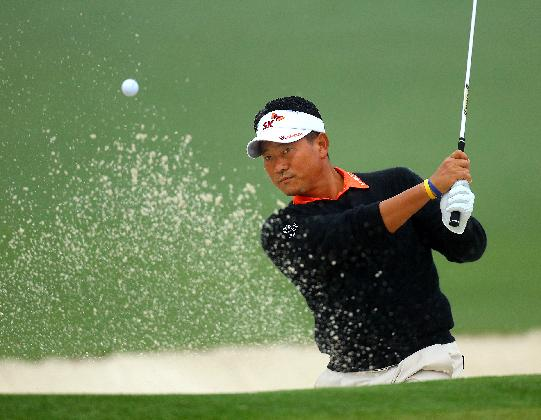 K.J. Choi, of South Korea, hits from a sand trap to the second green during practice for the Masters golf tournament Monday, April 7, 2014 in Augusta, Ga