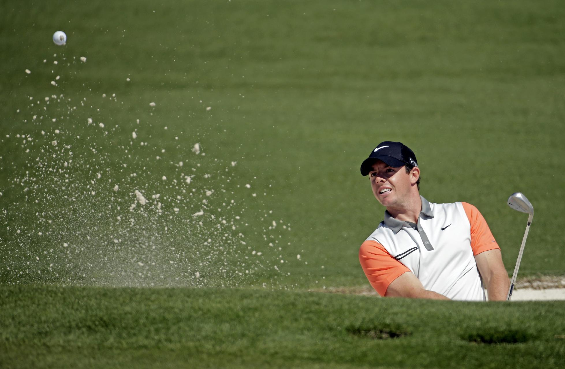 Rory McIlroy, of Northern Ireland, hits out of a bunker on the second green during the first round of the Masters golf tournament Thursday, April 10, 2014, in Augusta, Ga