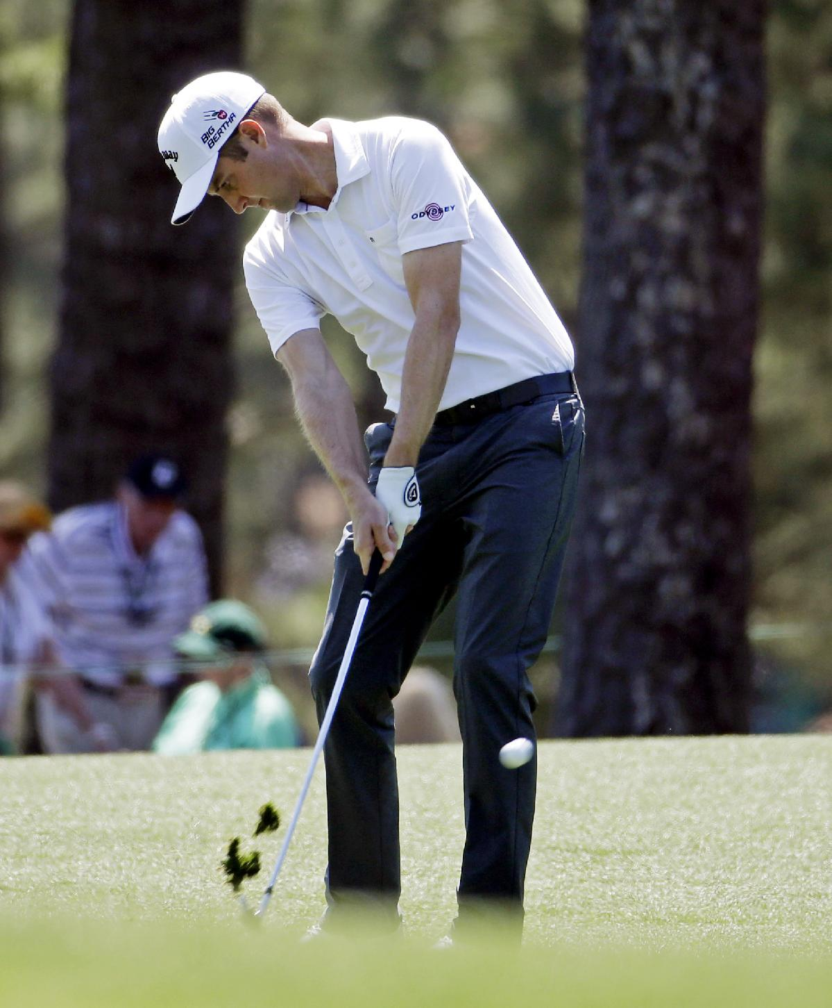 Chris Kirk hits off the first fairway during the first round of the Masters golf tournament Thursday, April 10, 2014, in Augusta, Ga