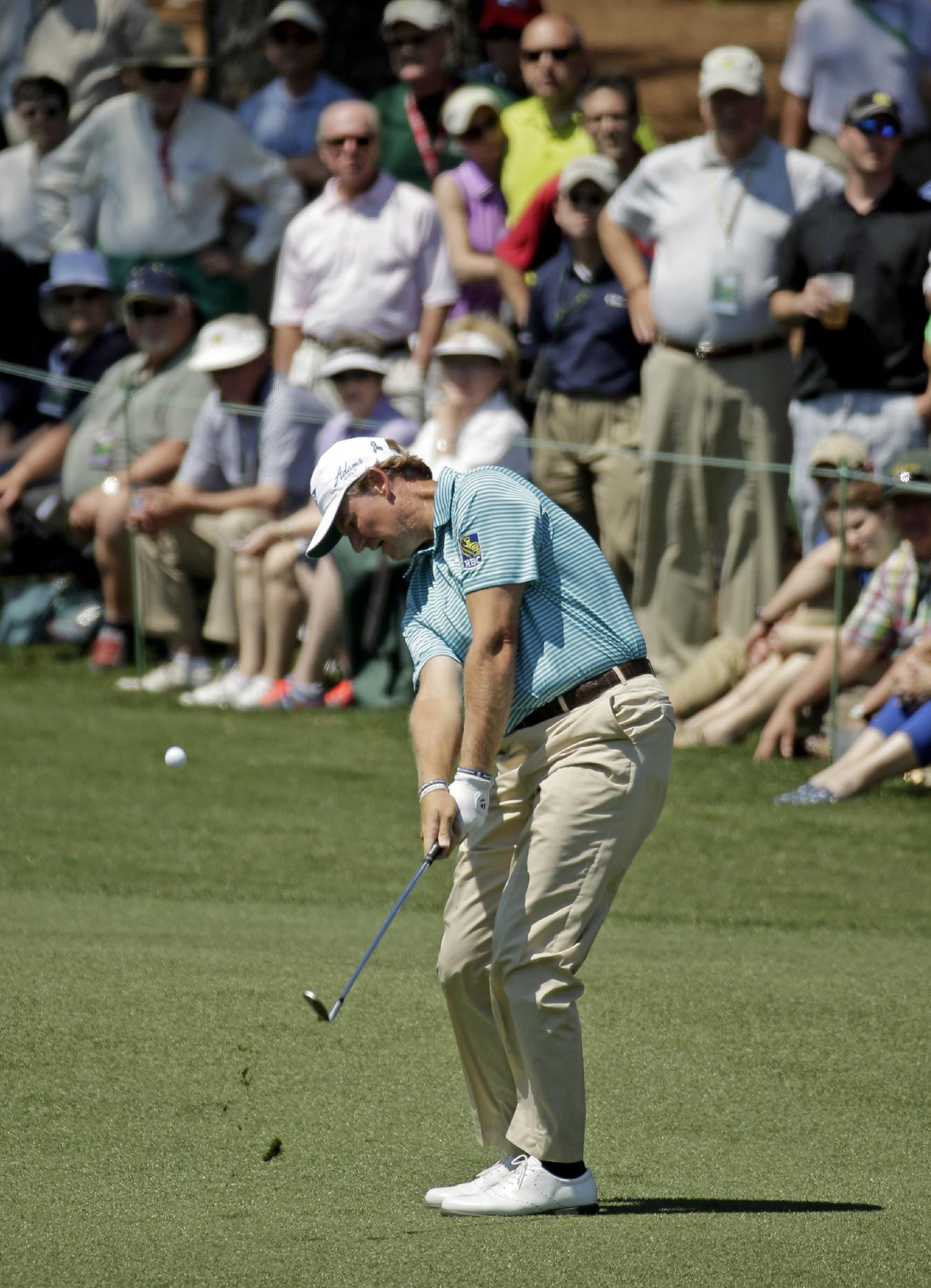 Ernie Els, of South Africa, hits to the second green during the first round of the Masters golf tournament Thursday, April 10, 2014, in Augusta, Ga