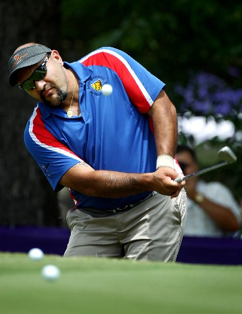 Isaac Sanchez practices on the chipping green during practice rounds for the St. Jude Classic golf tournament, Tuesday, June 3, 2014, in Memphis, Tenn. Sanchez won a Golf Channel reality show to earn an exemption for the tournament