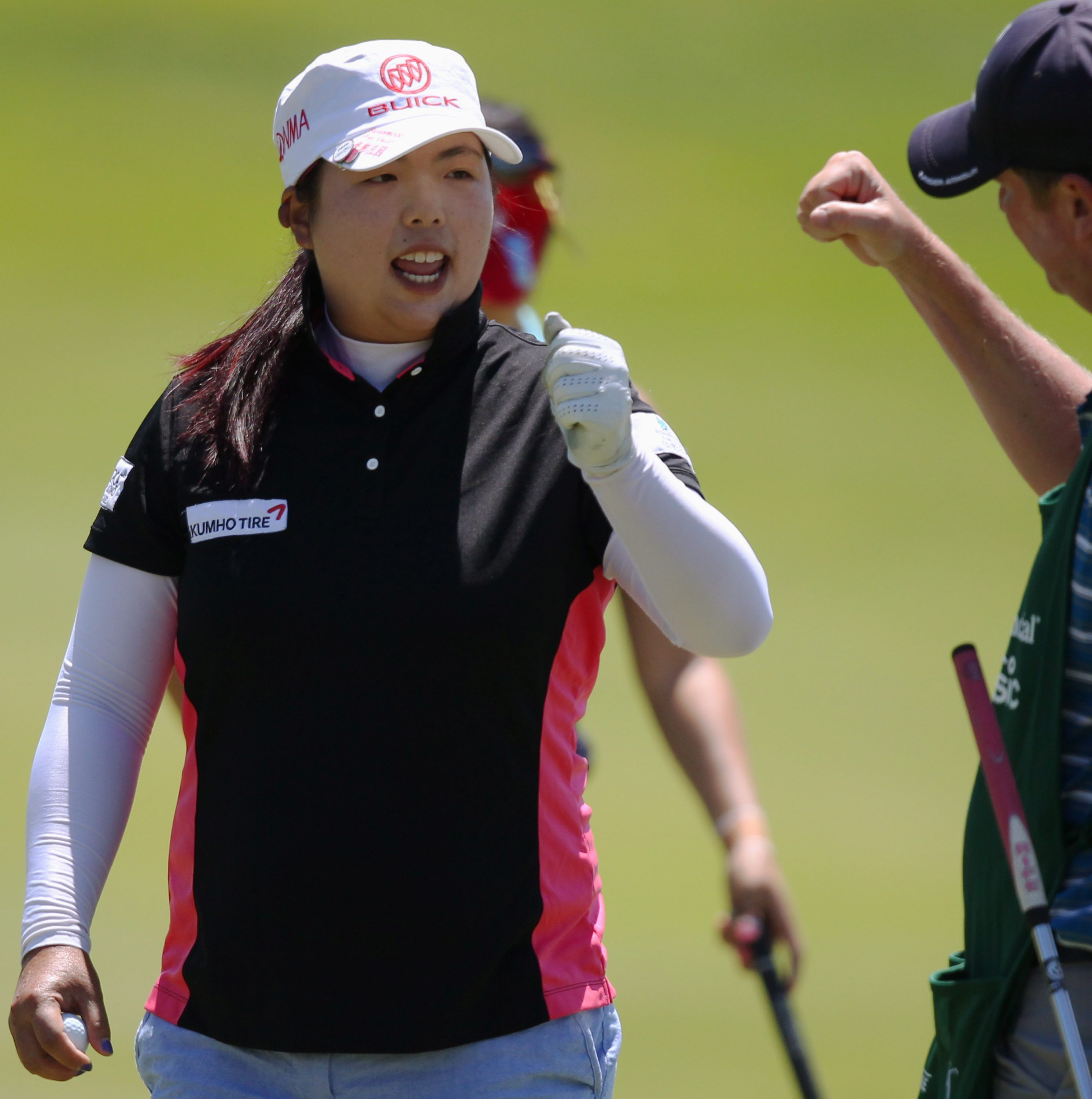 Shanshan Feng celebrates after making an eagle on the fifth hole during the third round of the Manulife Financial LPGA Classic golf tournament Saturday, June 7, 2014 in Waterloo, Ontario
