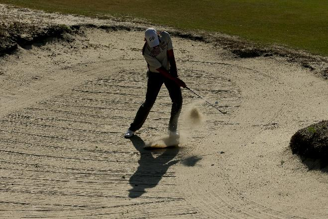 Aaron Baddeley, of Australia, hits out of the bunker on the fifth hole during a practice round for the U.S. Open golf tournament in Pinehurst, N.C., Tuesday, June 10, 2014. The tournament starts Thursday