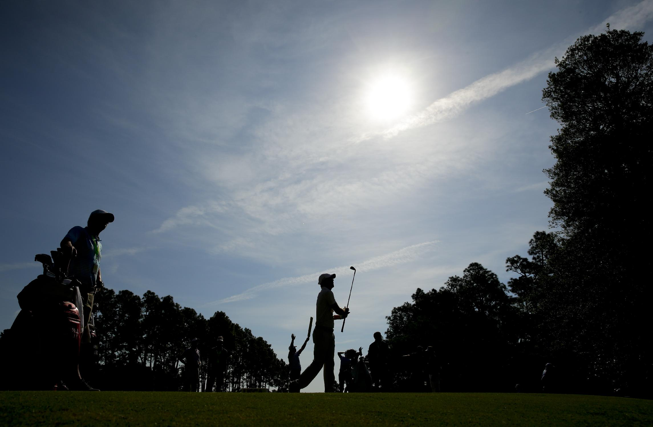 Russell Henley watches his tee shot on the seventh hole during a practice round for the U.S. Open golf tournament in Pinehurst, N.C., Tuesday, June 10, 2014. The tournament starts Thursday