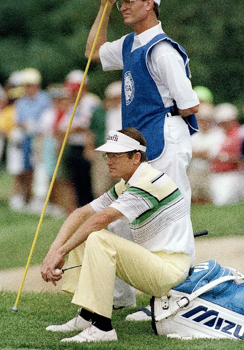 In this Aug. 12, 1989, file photo, pro golfer Mike Reid reacts after sinking a putt on the second hole at Kemper Lakes during the third round of the PGA Championships in Hawthorn Lakes, Ill. Reid is known as a straight driver, his nickname was
