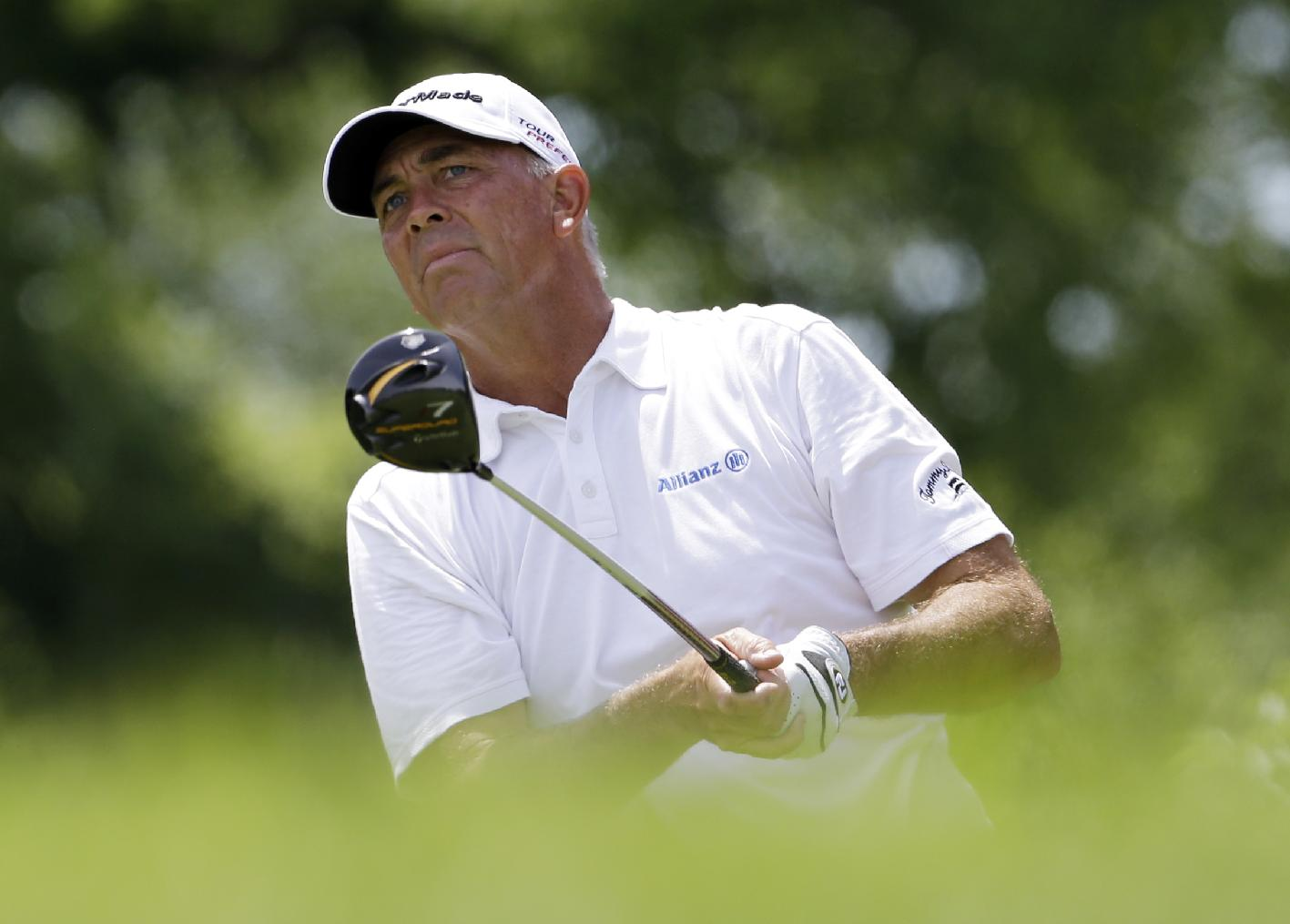 Tom Lehman watches his tee shot on the third hole during the final round of the Encompass Championship golf tournament in Glenview, Ill., Sunday, June 22, 2014