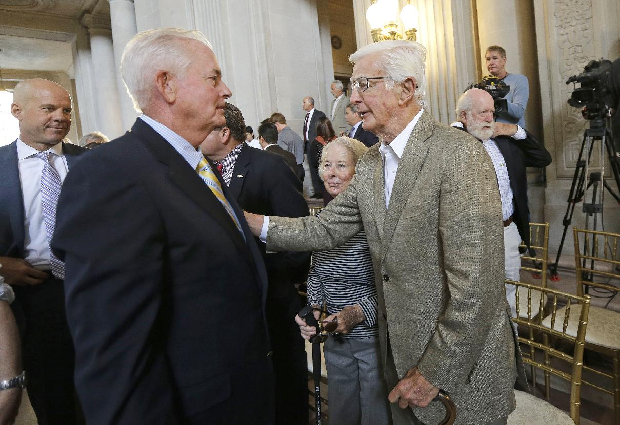 PGA of America President Ted Bishop, left, is greeted by Sandy Tatum, former president of the United States Golf Association, after a news conference announcing that TPC Harding Park will host the U.S. PGA Championship in 2020 and the Presidents Cup in 2025 at City Hall in San Francisco, Wednesday, July 2, 2014. TPC Harding Park will also host the Match Play Championship in 2015