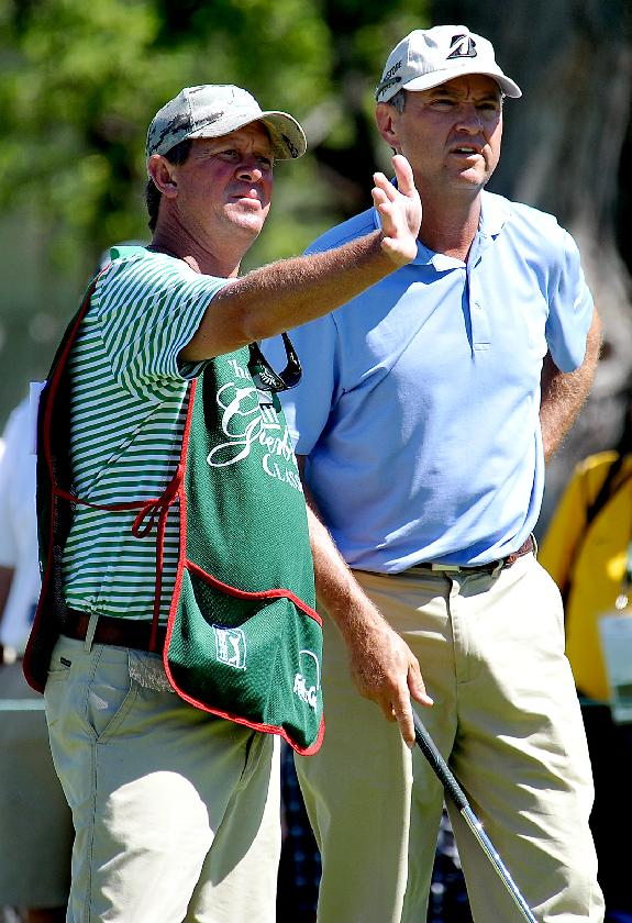 Davis Love III, right, talks with his caddie, Jeff Weber, on the 18th tee during the third round of the Greenbrier Classic golf tournament at Greenbrier Resort in White Sulphur Springs, W.Va., Saturday, July 5, 2014
