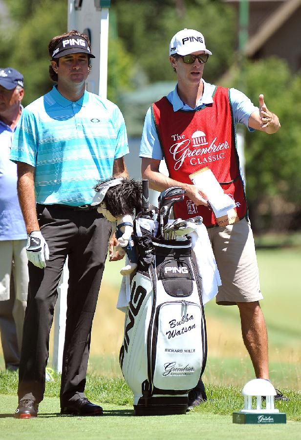 Bubba Watson, left and his caddie, Ted Scott, discuss eighth hole during the third round of the Greenbrier Classic golf tournament at Greenbrier Resort in White Sulphur Springs, W.Va., Saturday, July 5, 2014