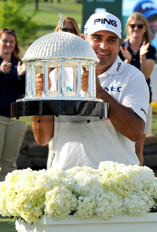 Angel Cabrera holds up The Greenbrier Classic Springhouse Trophy after winning the Greenbrier Classic golf tournament at the Greenbrier Resort in White Sulphur Springs, W.Va., Sunday, July 6, 2014