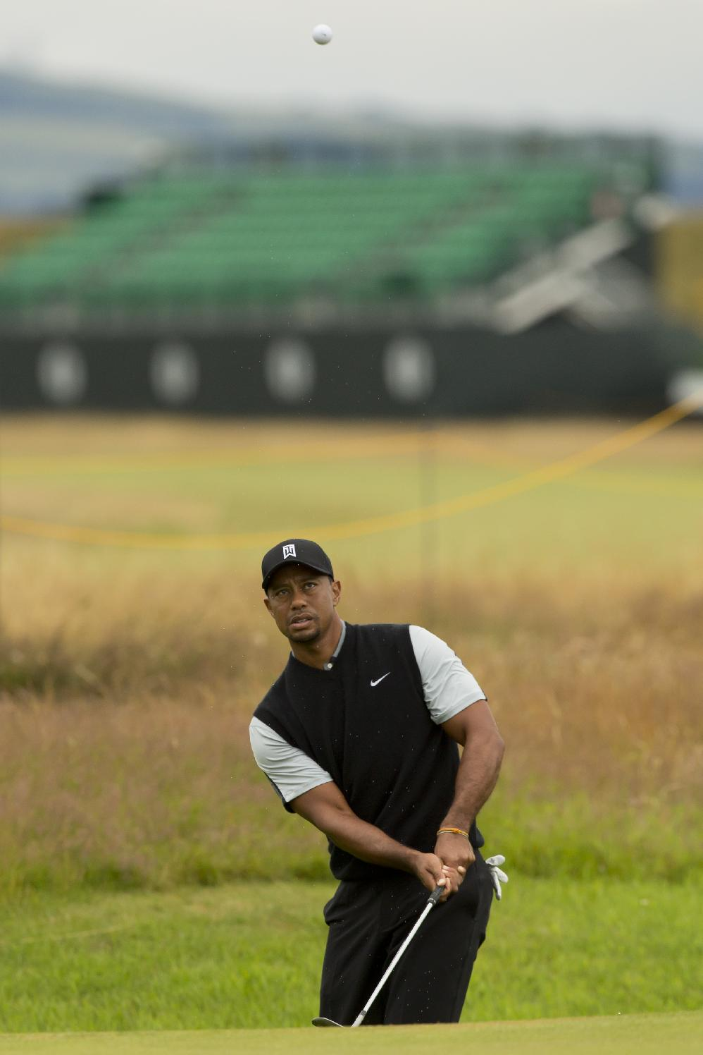 Tiger Woods of the US plays a shot to the 16th green during a practice round at Royal Liverpool Golf Club prior to the start of the British Open Golf Championship, in Hoylake, England, Saturday, July 12, 2014. The 2014 Open Championship starts on Thursday, July 17