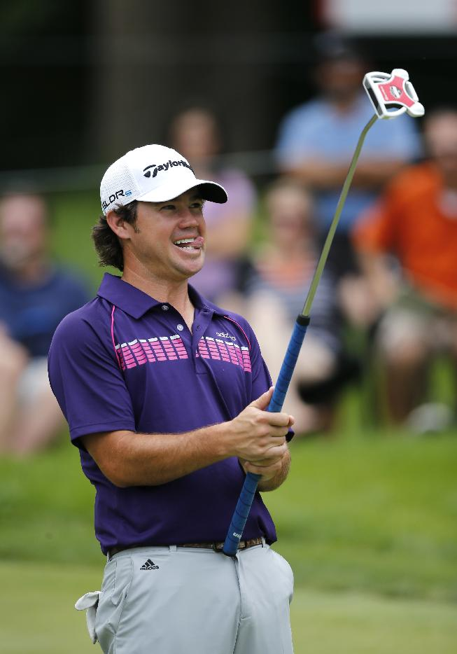 Brian Harman reacts after missing a birdie on the ninth hole during the third round of the 2014 John Deere Classic golf tournament at TPC Deere Run in Silvis, Ill., Saturday, July 12, 2014