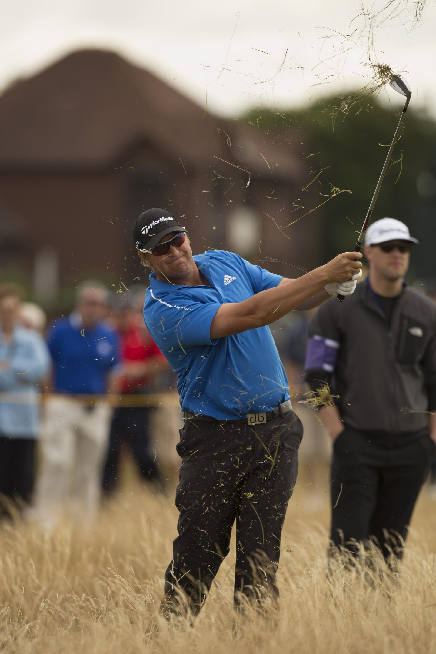 Dawie van der Walt of South Africa plays out of the rough on the sixth hole during a practice round at Royal Liverpool Golf Club prior to the start of the British Open Golf Championship, in Hoylake, England, Monday, July 14, 2014. The 2014 Open Championship starts on Thursday, July 17