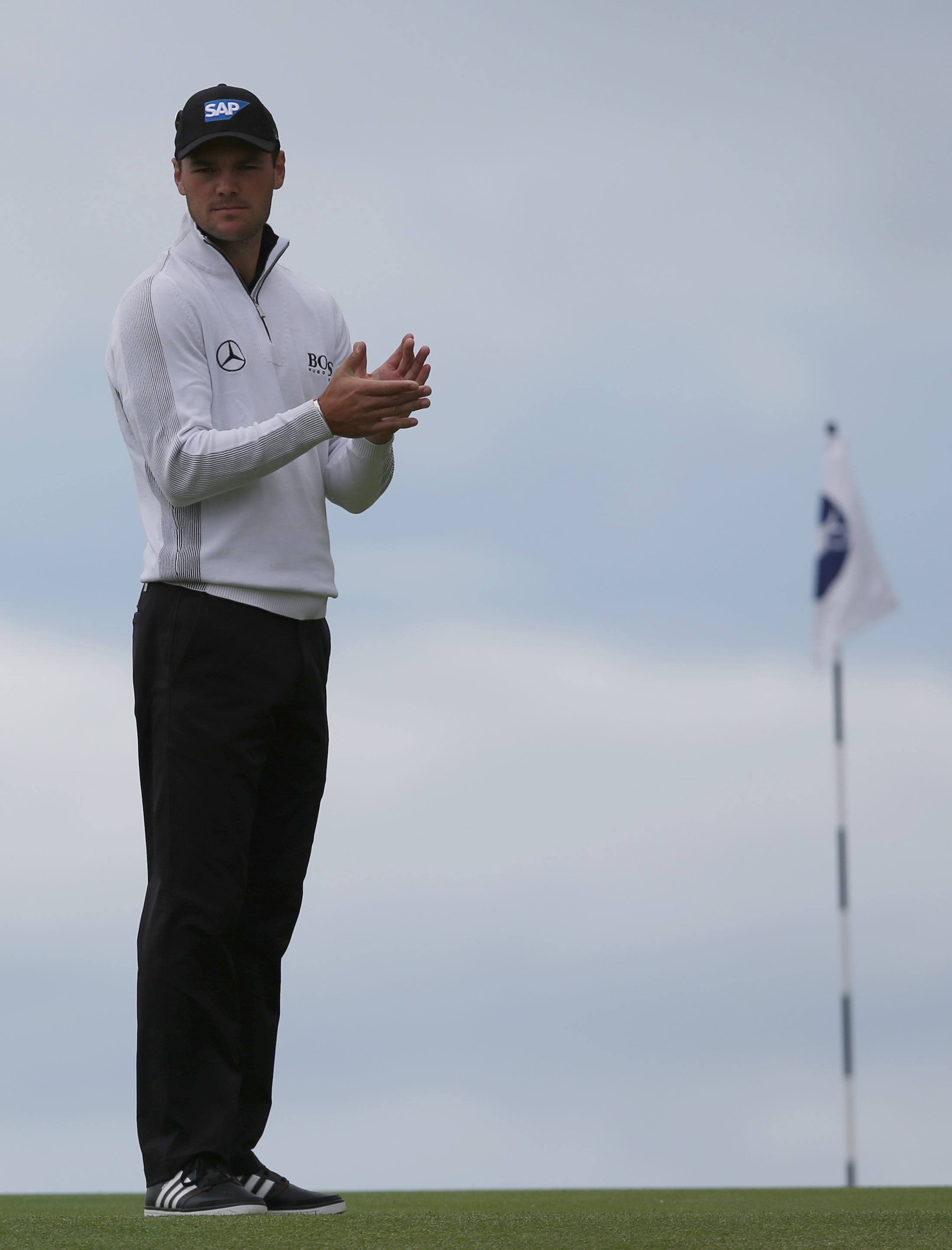 Martin Kaymer of Germany waits to putt on the 13th green during a practice round ahead of the British Open Golf championship at the Royal Liverpool golf club, Hoylake, England, Wednesday July 16, 2014. The British Open Golf championship starts Thursday July 17