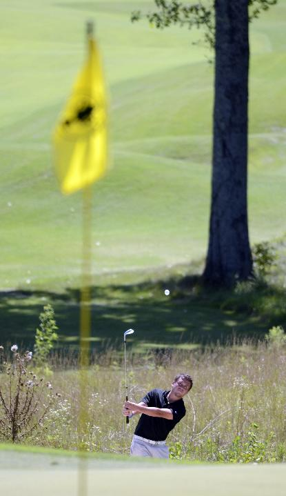 Korey Smith chips to a green during the Southern Amateur Championship golf tournament Wednesday, July 16, 2014, at the Honors Course in Ooltewah, Tenn