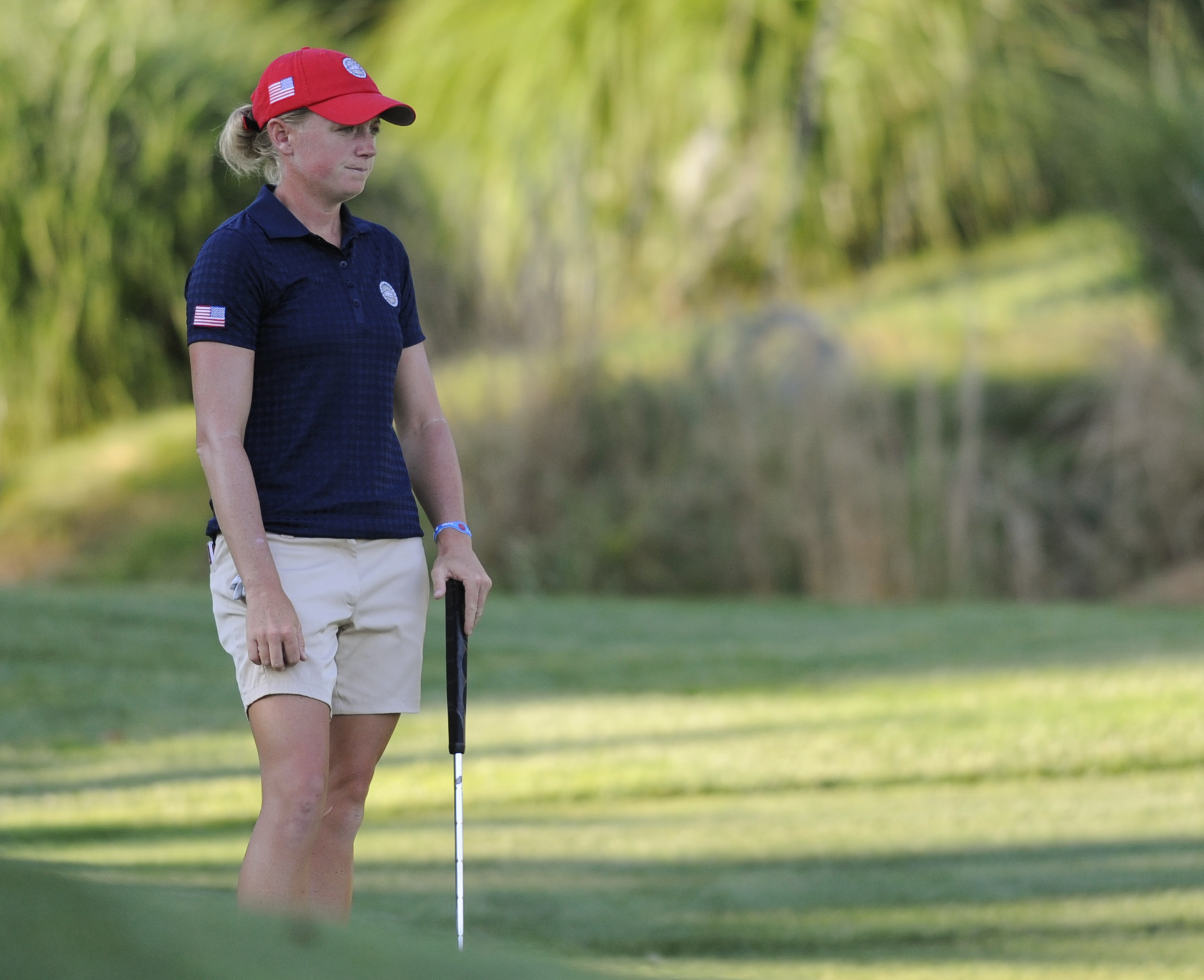 United States' Stacy Lewis reacts after missing a putt on the 18th hole during the third round of the International Crown golf tournament Saturday, July 26, 2014, in Owings Mills, Md