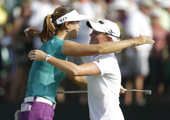 Michelle Wie, left, hugs runner-up Stacy Lewis, right, after winning the U.S. Women's Open golf tournament in Pinehurst, N.C., Sunday, June 22, 2014