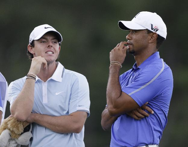 In this June 13, 2013, file photo, Rory McIlroy, left, and Tiger Woods stand together during the first round of the U.S. Open golf tournament at Merion Golf Club in Ardmore, Pa. Anyone could see McIlroy had the gifts to be the next big thing in golf. His victory in the PGA Championship was more about grit. And now the comparisons with Woods are becoming inevitable